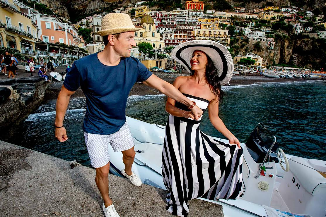 Newly weds stepping off boat in Positano Italy