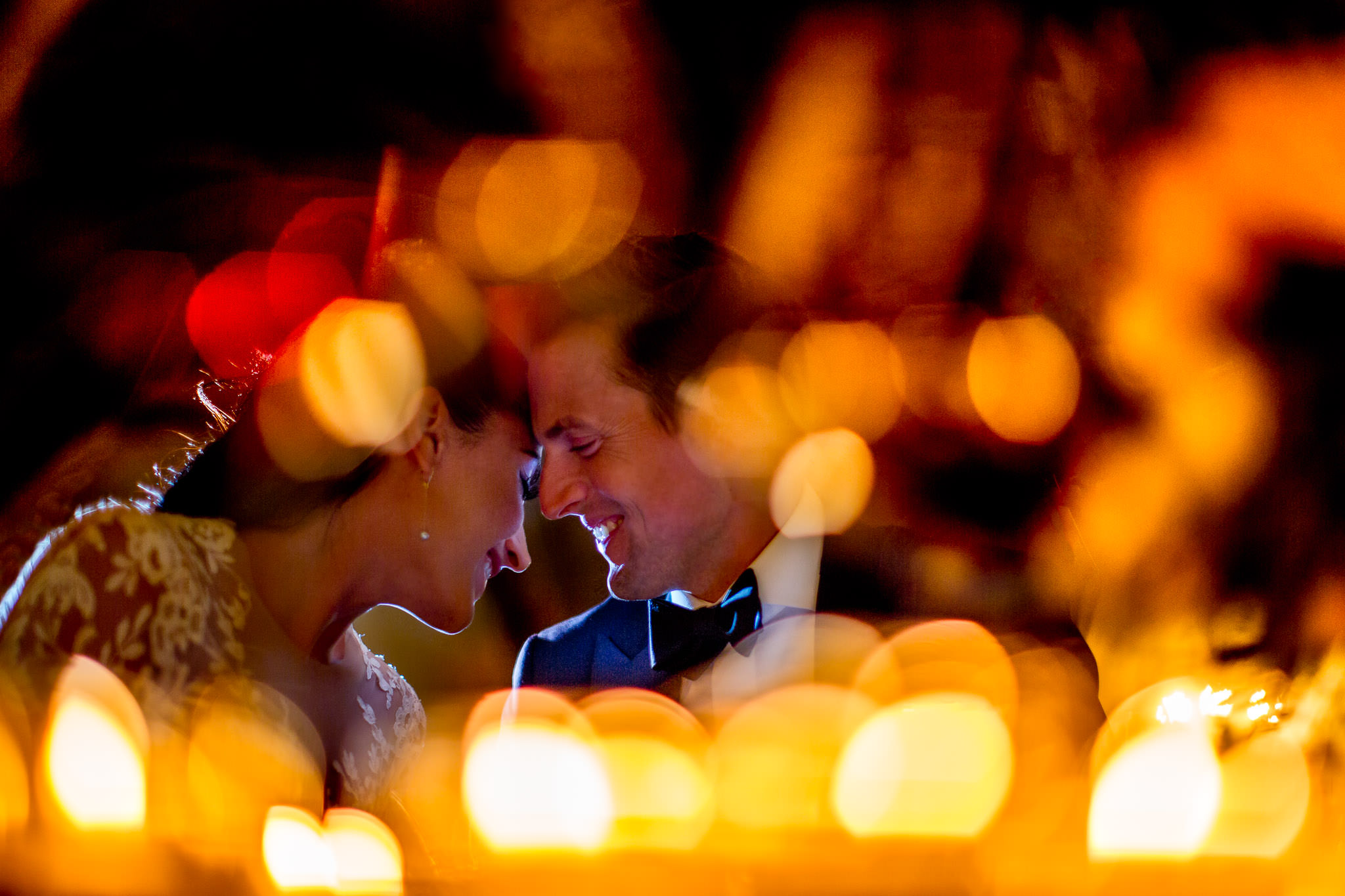 Bride and Groom laughing and embracing through candle light at Villa Cimbrone on Amalfi Coast in ItalyBride and Groom laughing and embracing through candle light at Villa Cimbrone on Amalfi Coast in Italy