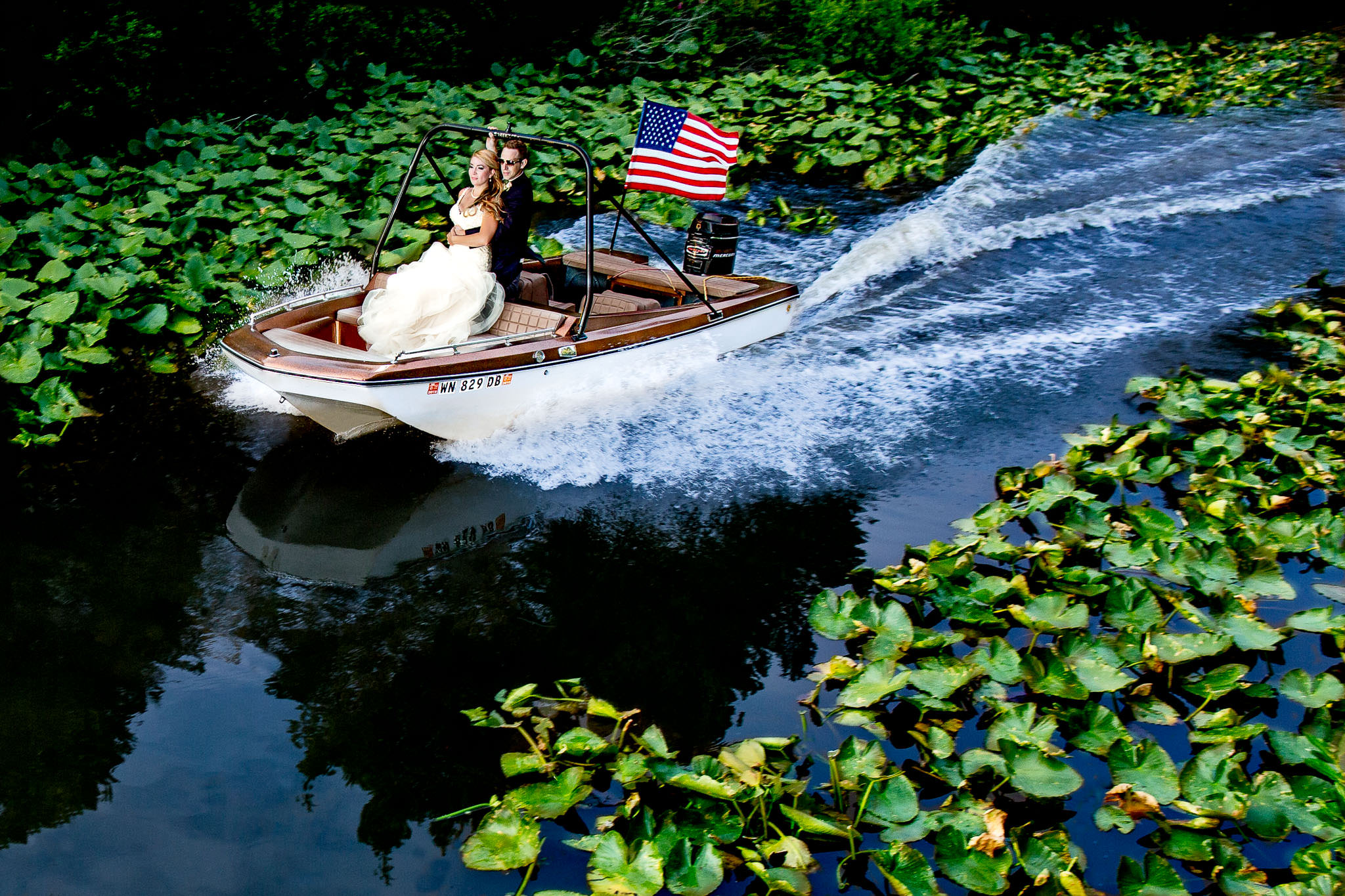 Bride and Groom full speed on boat in canal at Washington wedding