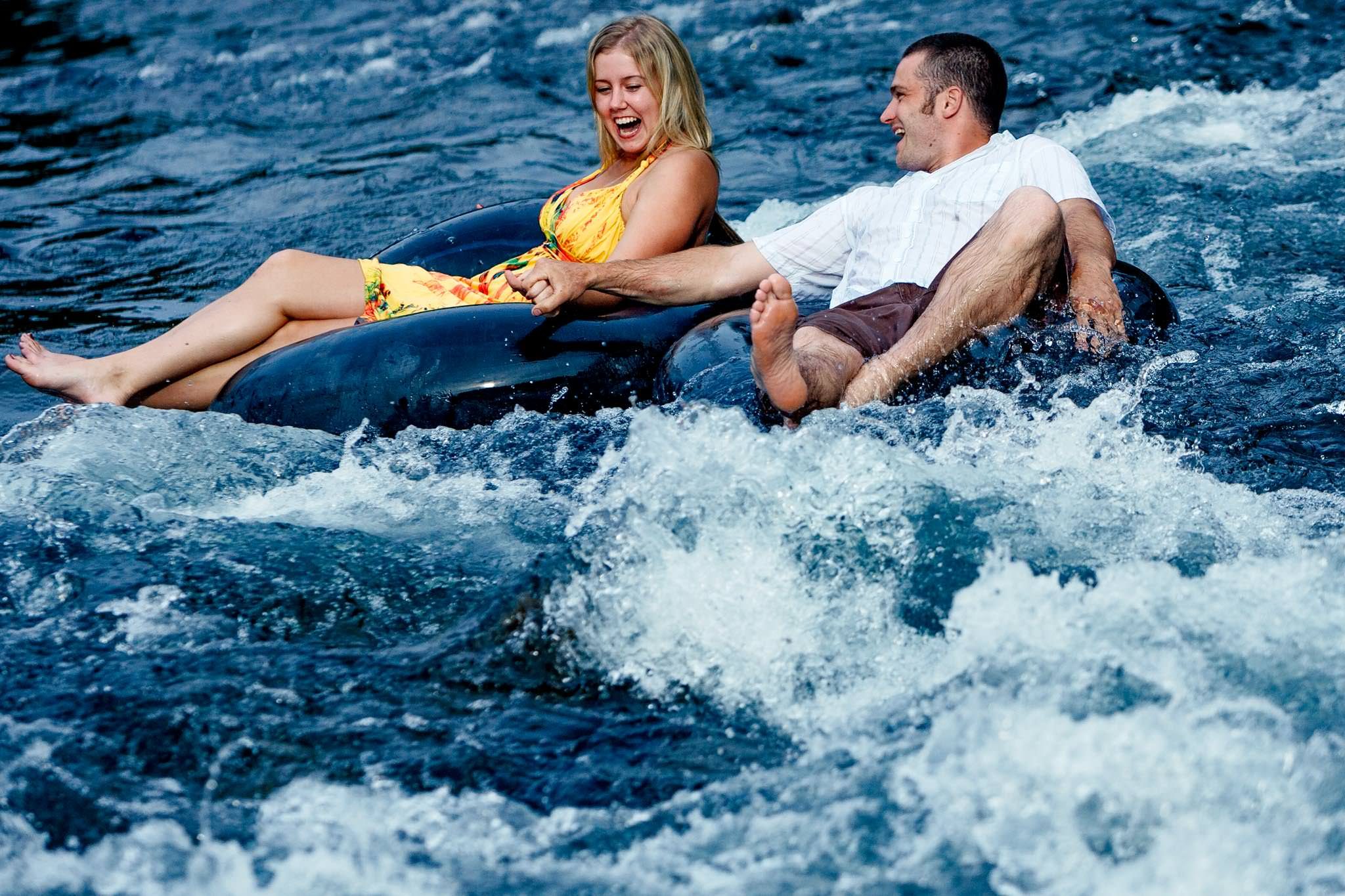 Engagement Portrait of Couple floating down river laughin