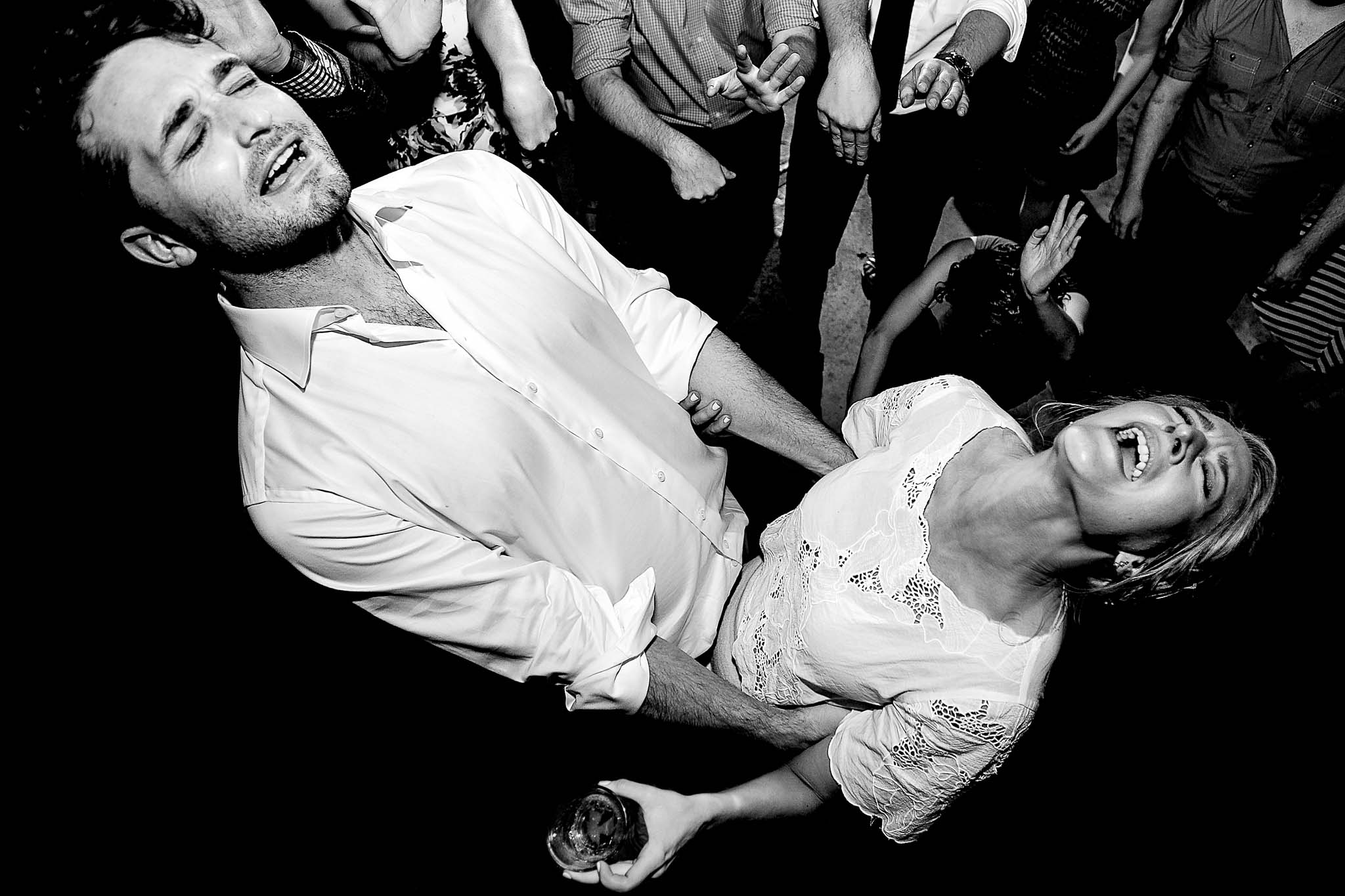 Bride and groom dancing wild on dance floor