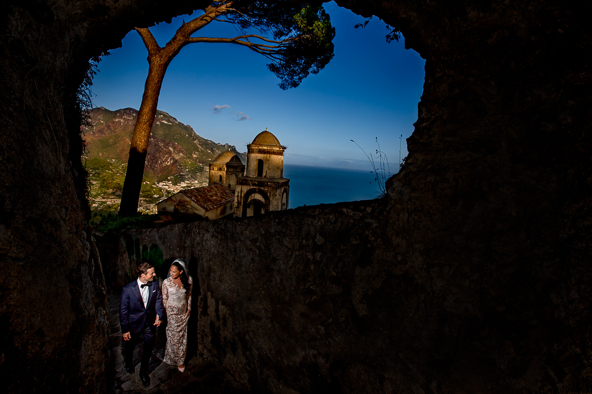 Bride and Groom walking in Ravello Italy overlooking Amalfi coast on wedding day
