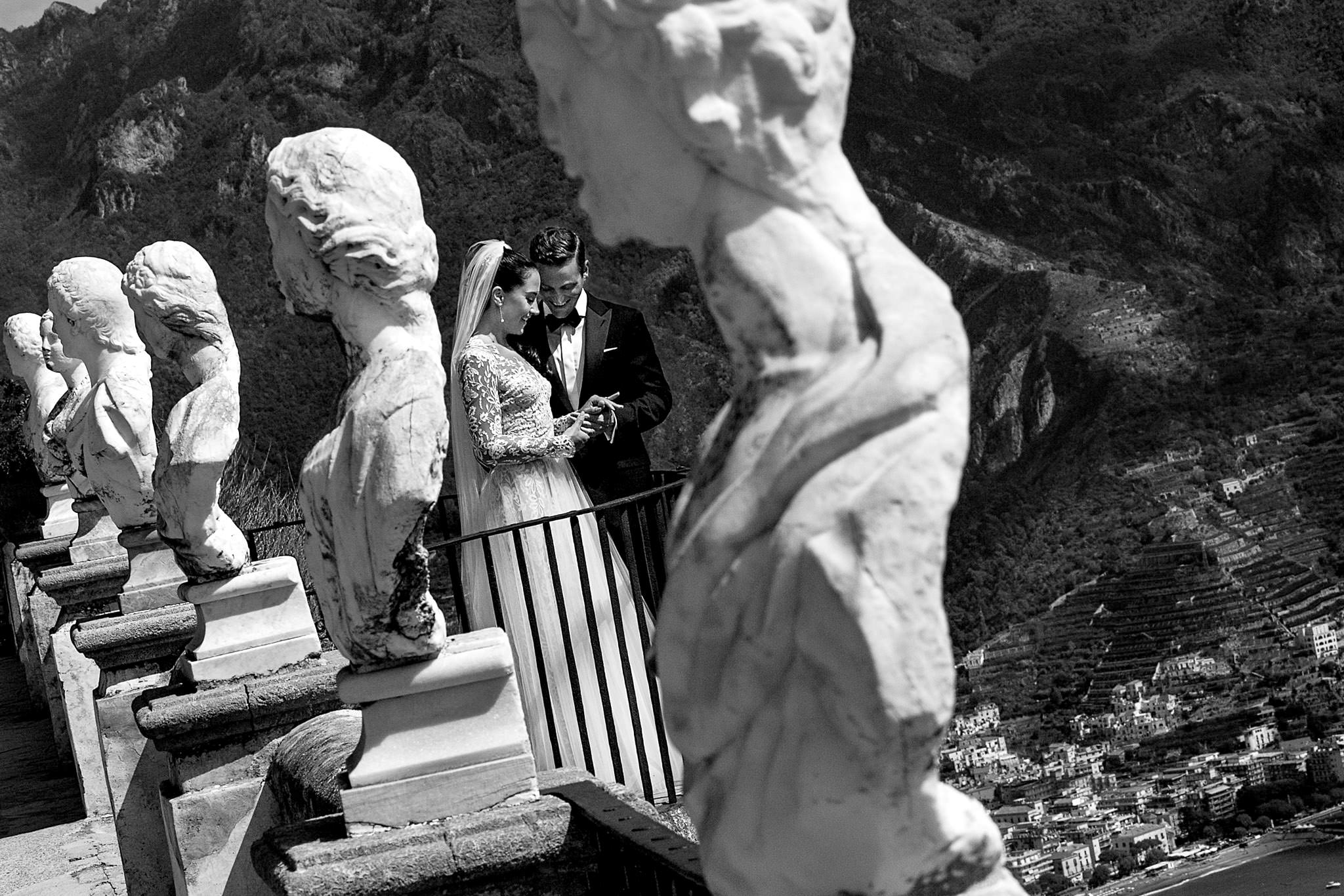 Bride and Groom looking out over Villa Cimbrone View while appreciating their wedding rings
