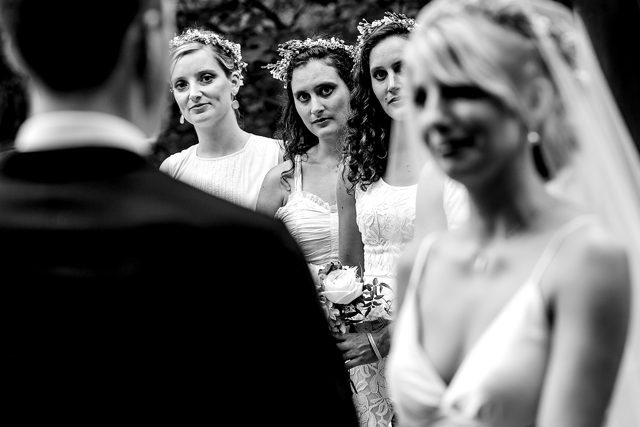 Bridesmaids in Ceremony at Oregon Wedding while listening to grooms vows