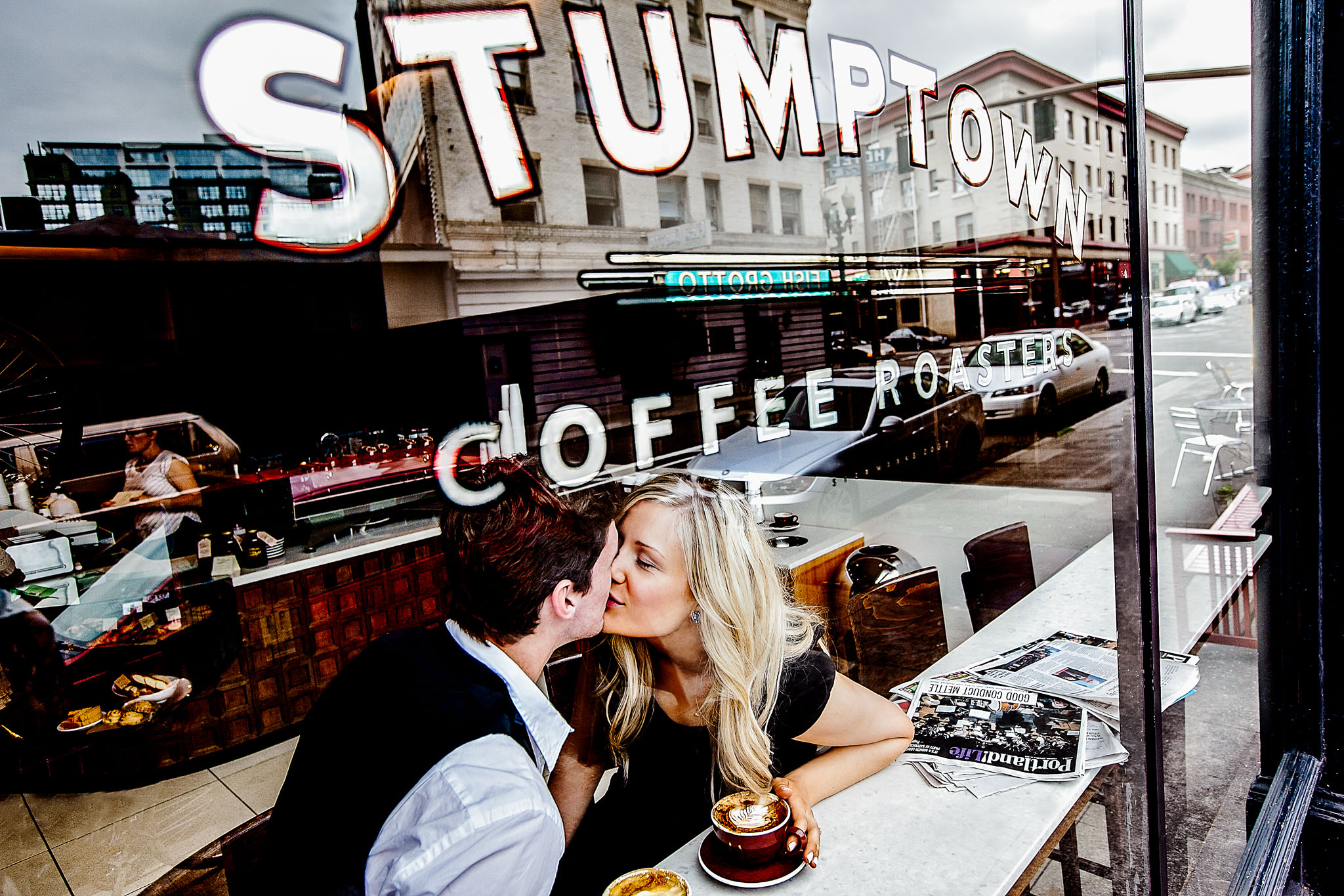 Stumptown Coffee Roasters with Engagement Photo through window in Portland Oregon