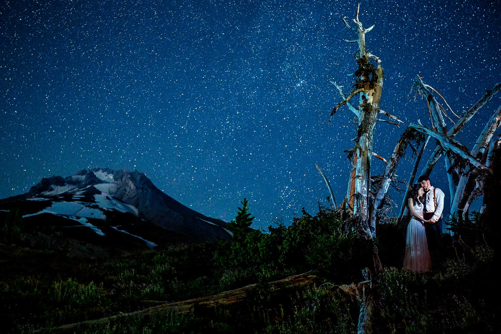 Bride and Groom under stars atop Mt Hood at Timberline Lodge