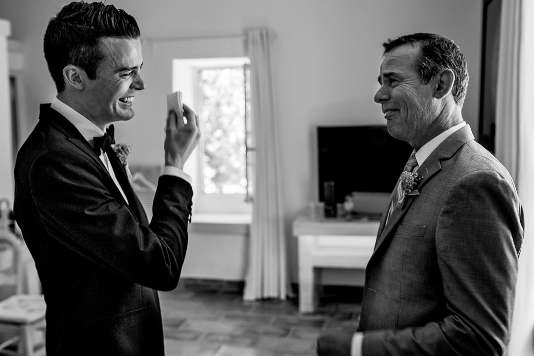 Groom and Father crying together before ceremony