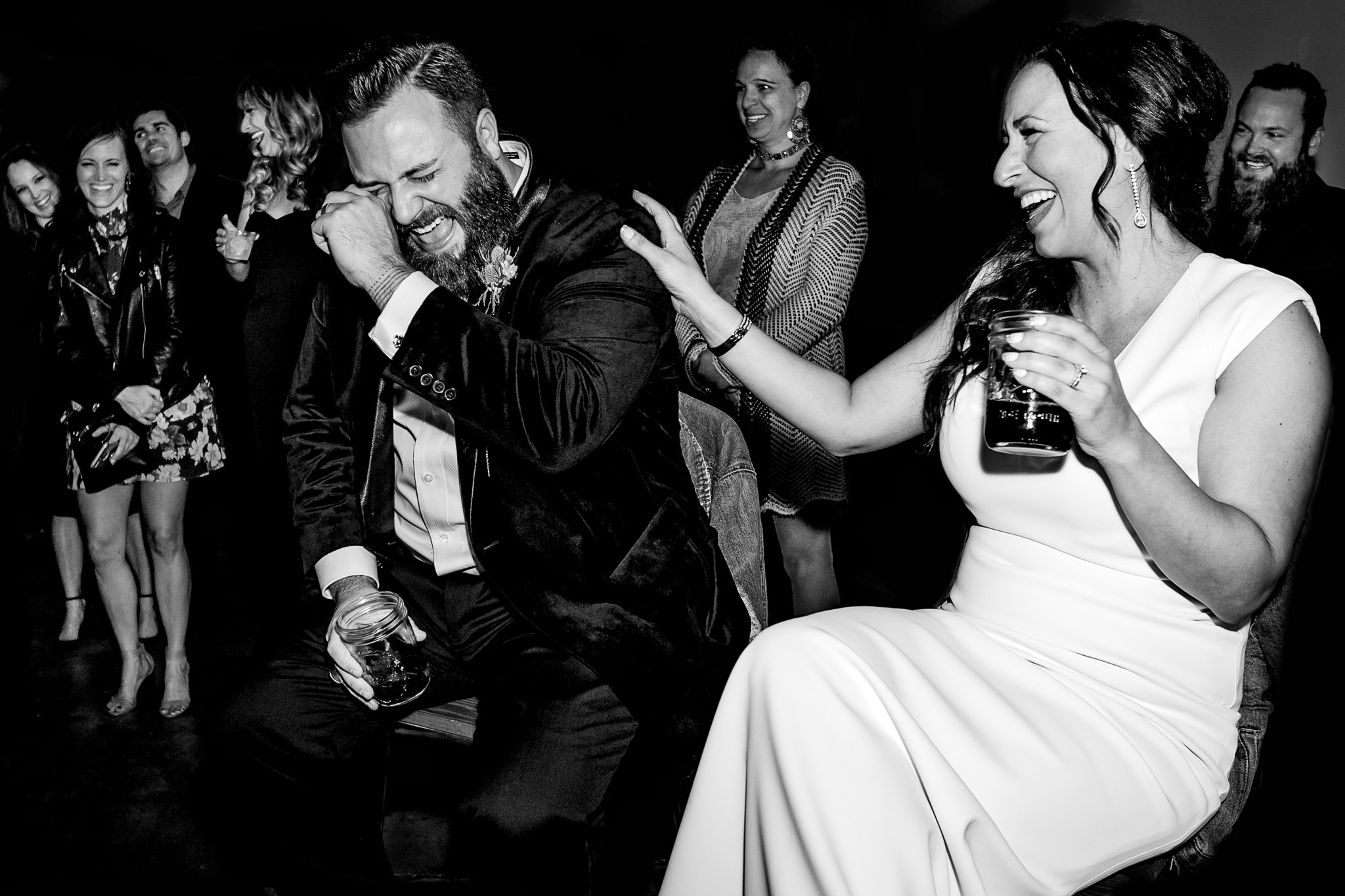 Bride and groom simultaneously laughing and crying