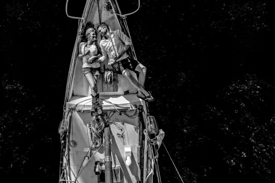 Engagement Portrait on Sail Boat St Johns Bridge black and white with black water and dark exposure