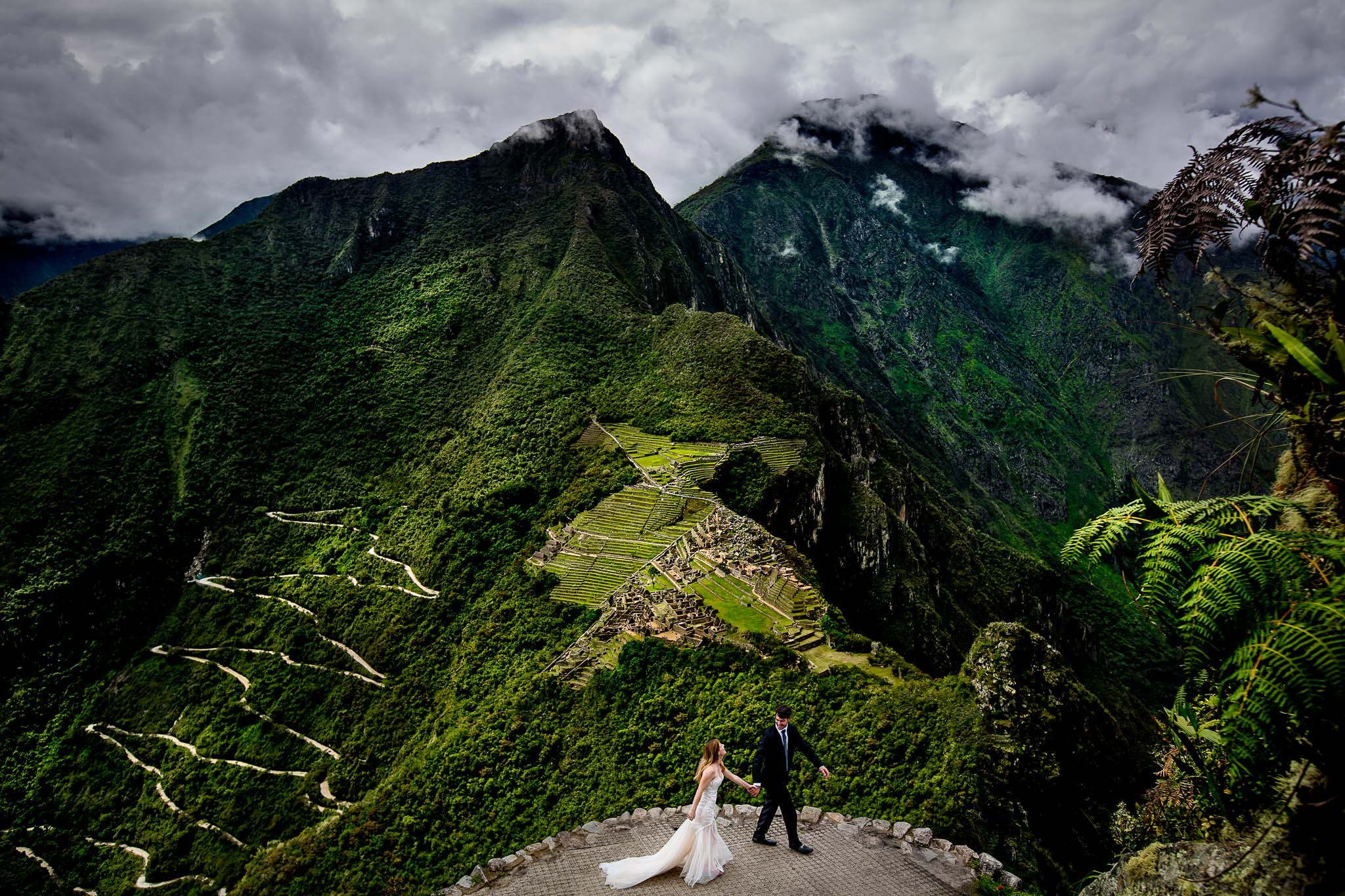 Bride and groom walking in Machu Picchu
