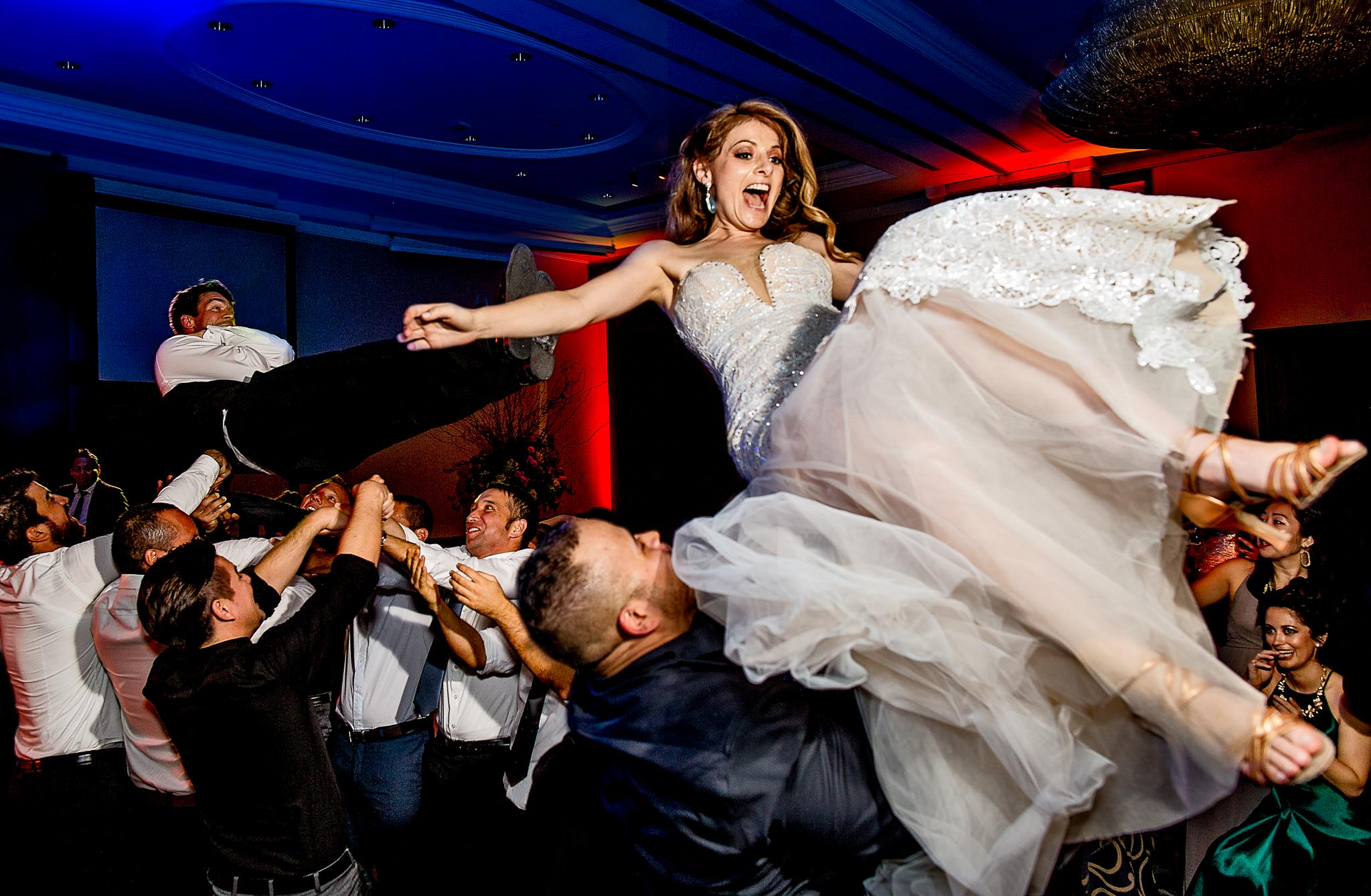 Bride and groom flying over dance floor in Peru at reception