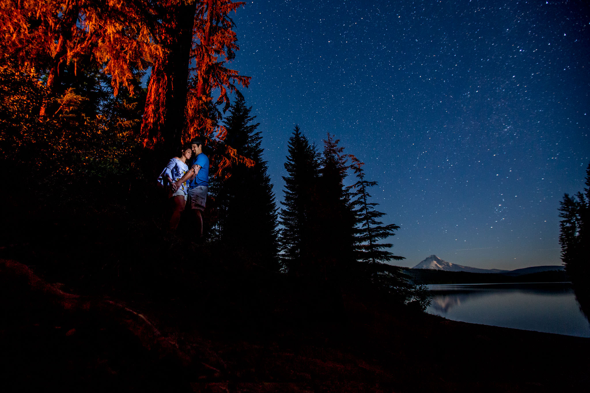 Engagement portrait near lake using astro photography with stars