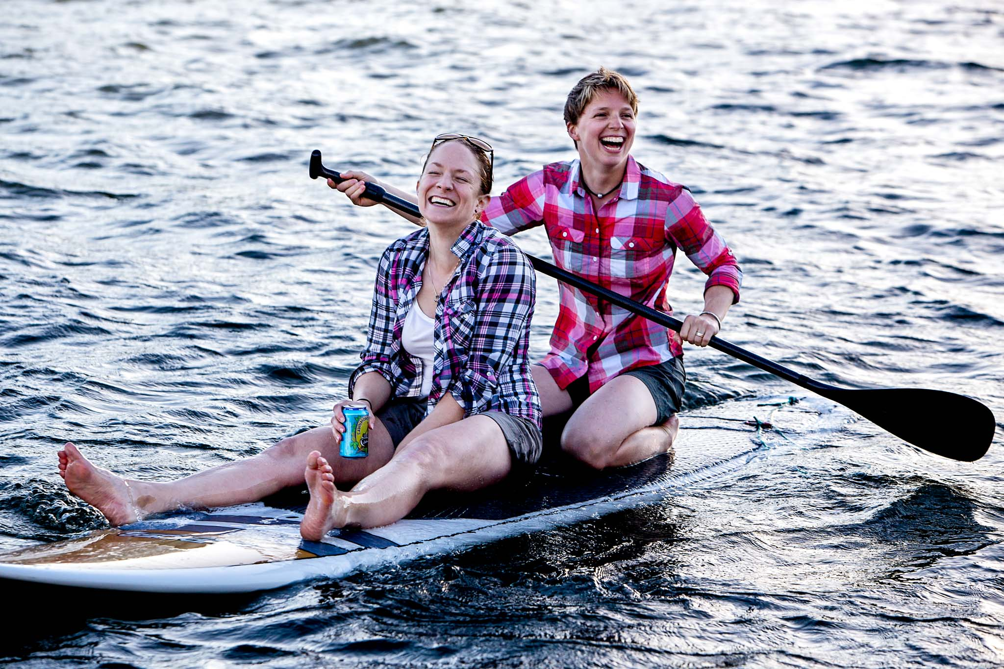 Same sex engagement shoot on paddle boards in Portland