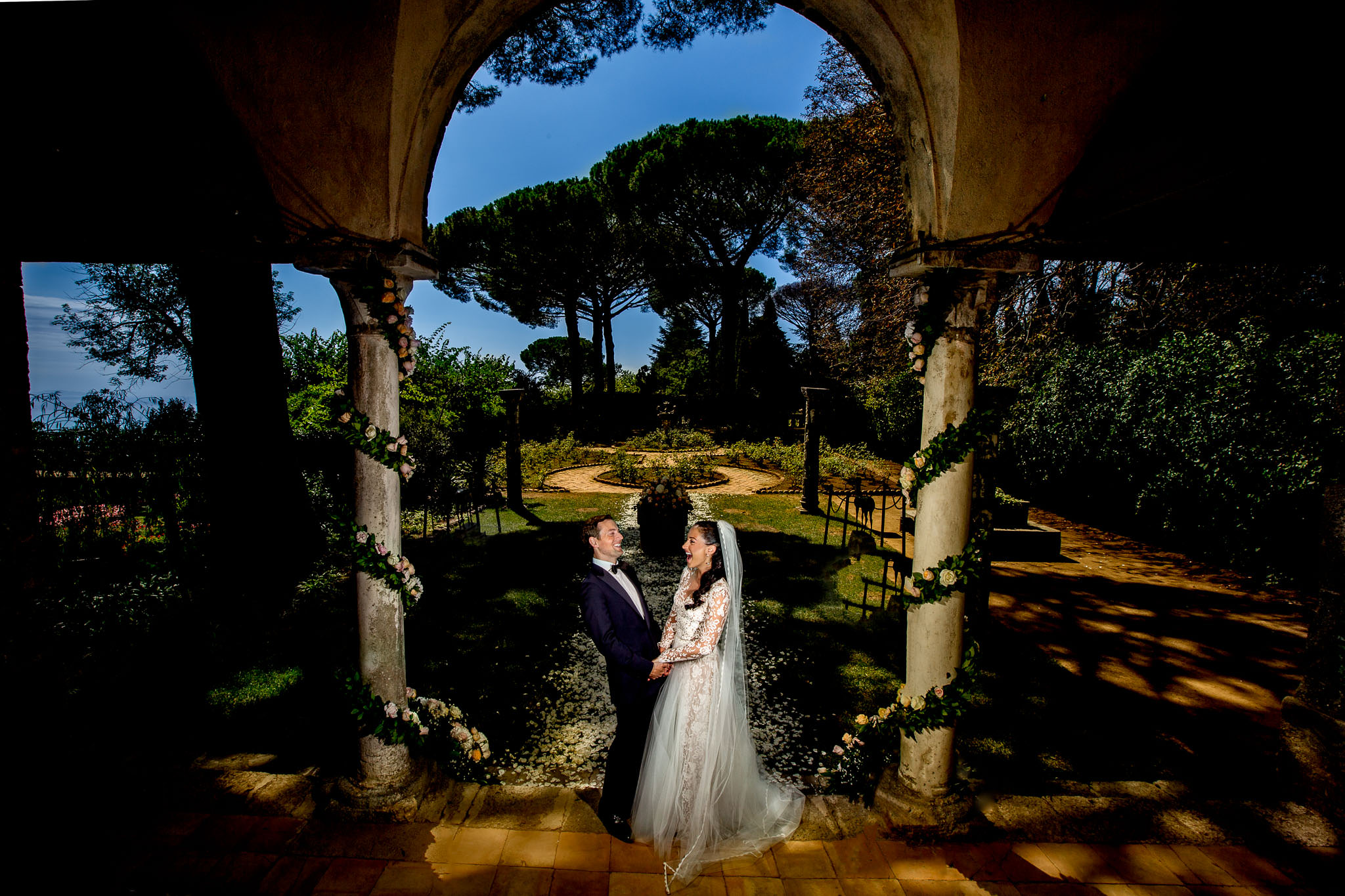Villa Cimbrone Wedding Amalfi Italy Bride and Groom Laughing in courtyard