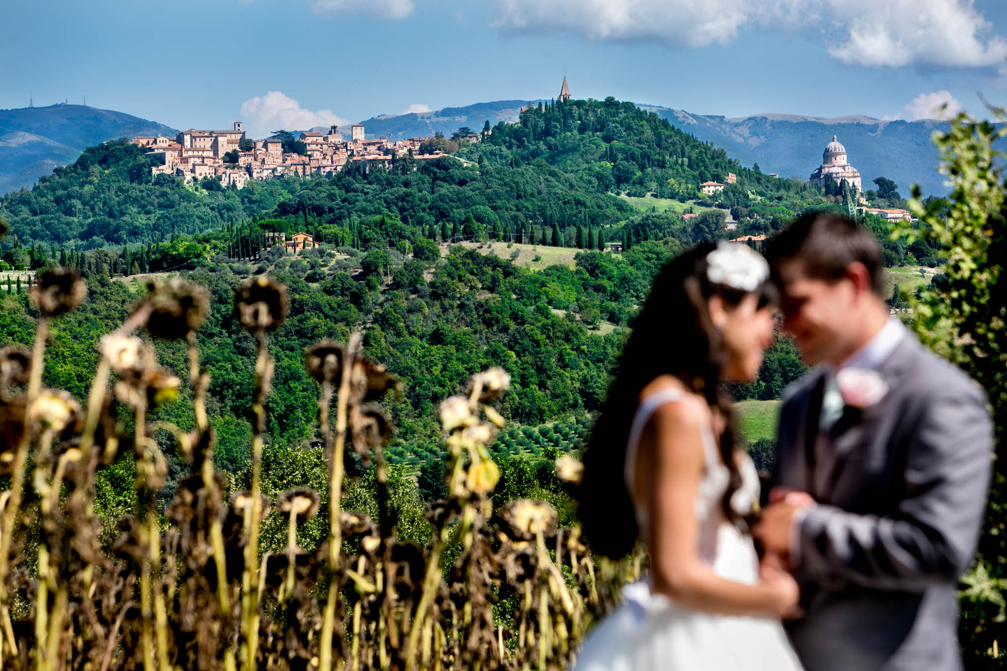 bride and groom with Umbria Italy hills looking toward Todi