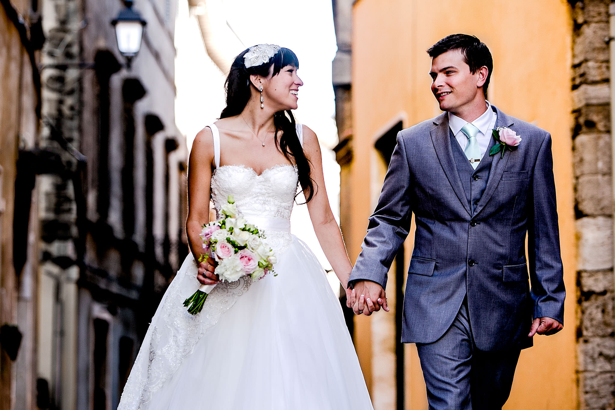 Bride and groom walking and laughing through Todi Italy in Umbria