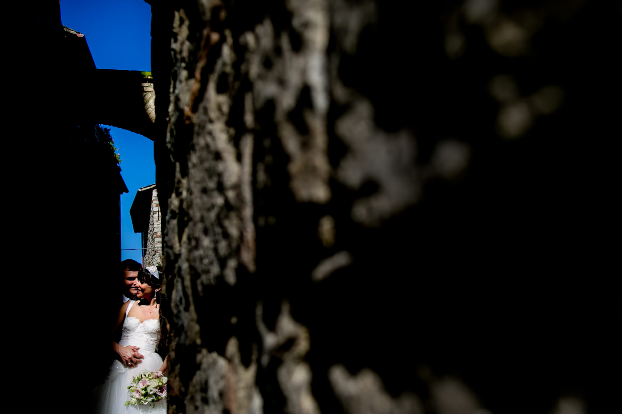 Bride and Groom snuggling in back street corners of Todi Italy in Umbria just before their ceremony