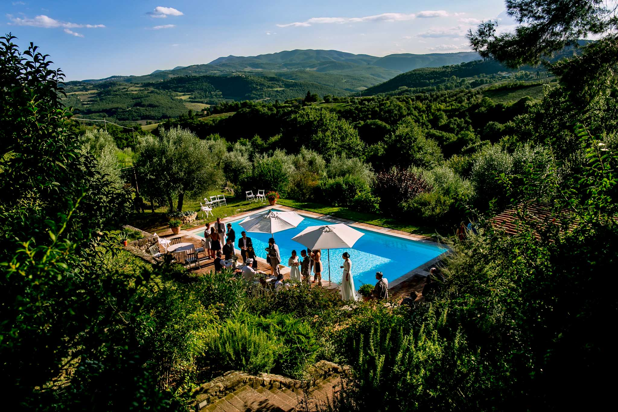 Pool side wedding reception party at Villa Tre Grazie in Umbria Italy near Todi