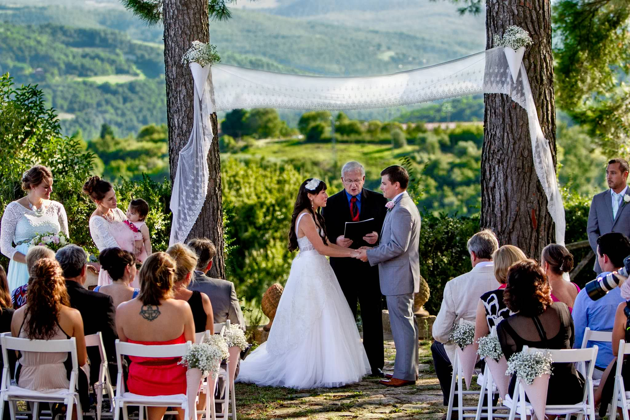Bride and Groom sharing vows in wedding ceremony at Villa Tre Grazie in Umbria Italy near Todi