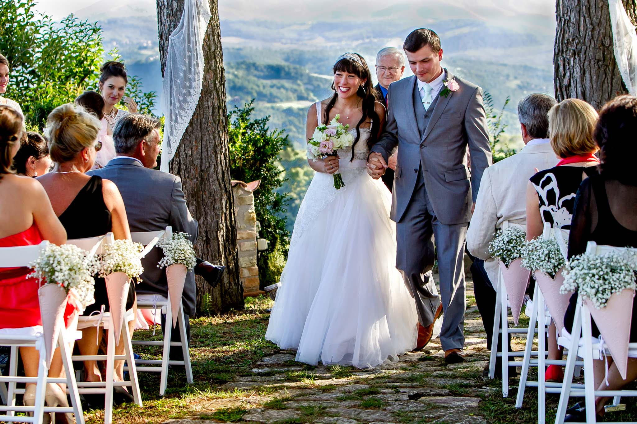 Bride and Groom exiting ceremony at Villa Tre Grazie in Umbria Italy near Todi