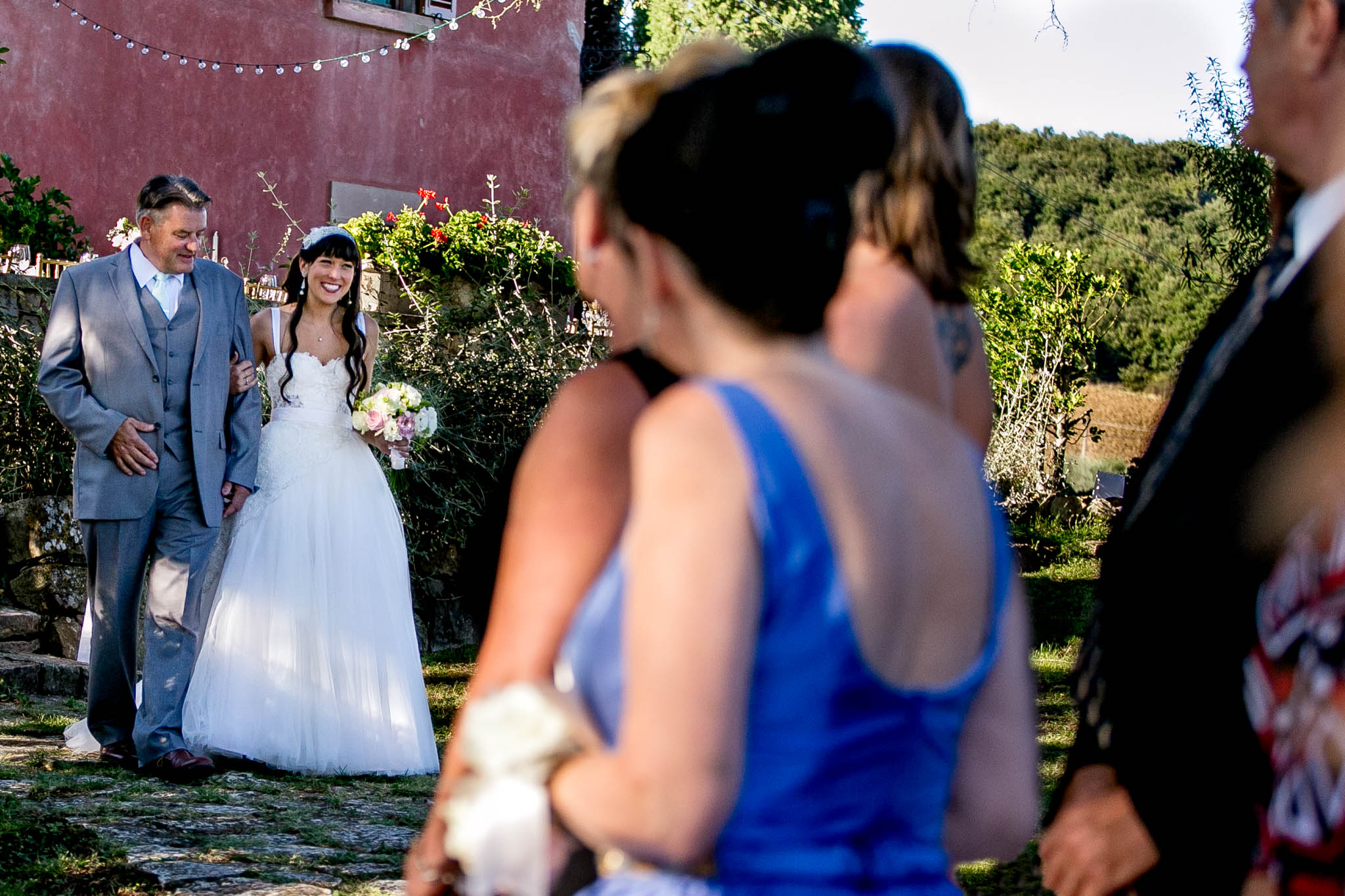 Bride walking into ceremony at Villa Tre Grazie in Umbria Italy near Todi