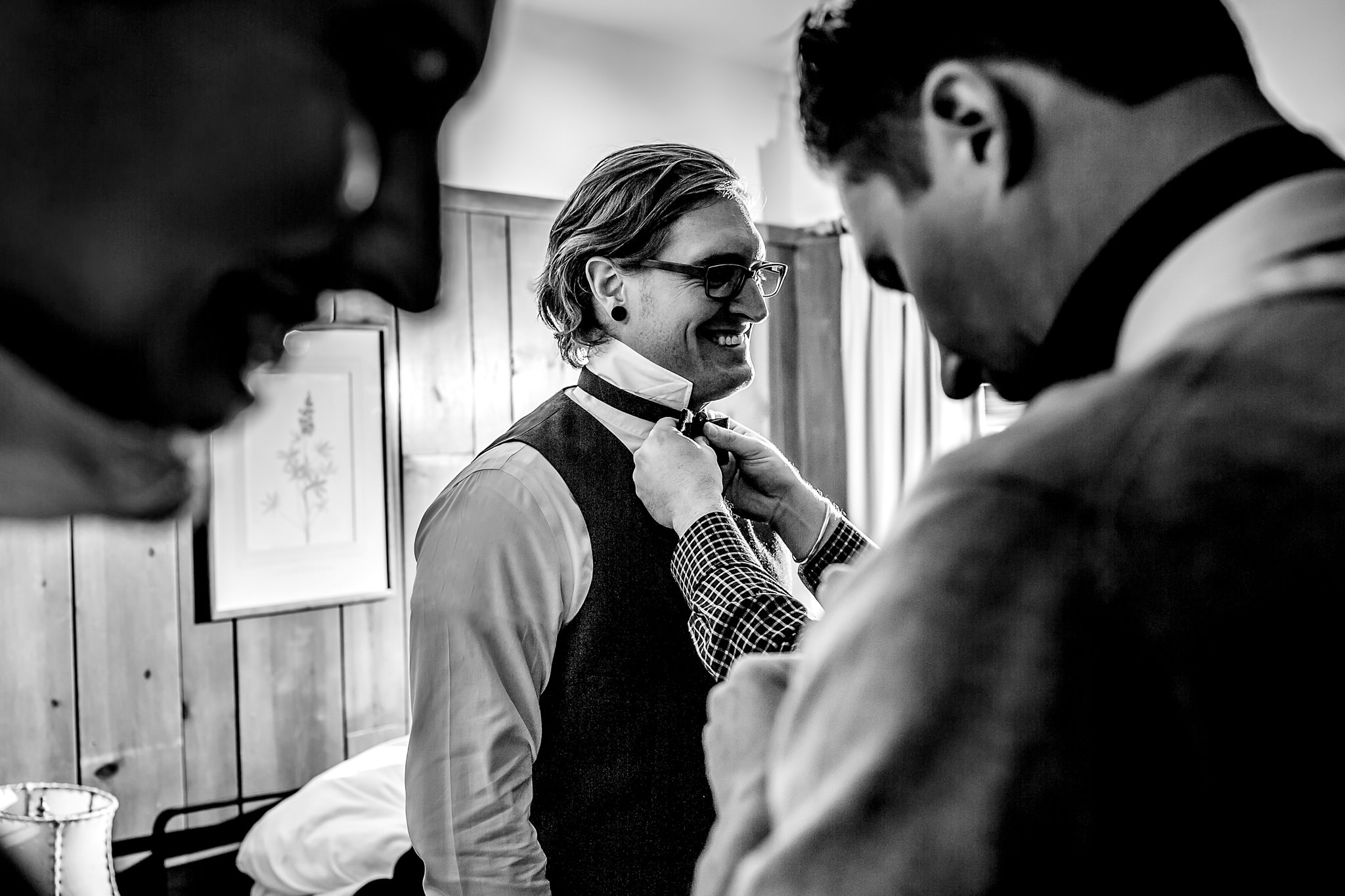 Groom getting ready at Timberline Lodge with friends
