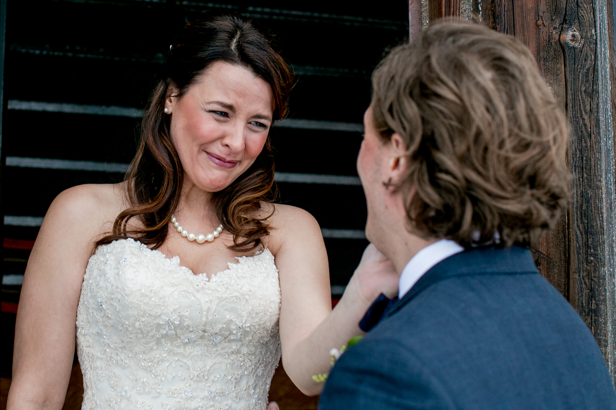 Bride seeing groom first time with emotional laughter and tears at Silcox Hut near Timberline Lodge