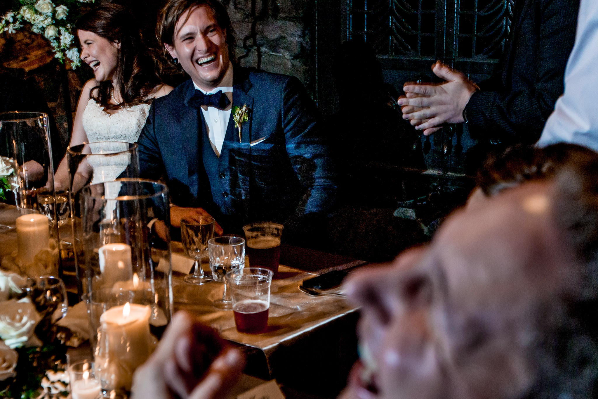 Bride and Groom laughing at reception at Silcox Hut above Timberline Lodge