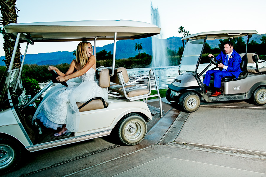 Bride and Groom playing on golf carts at Merv Griffin Estate Wedding