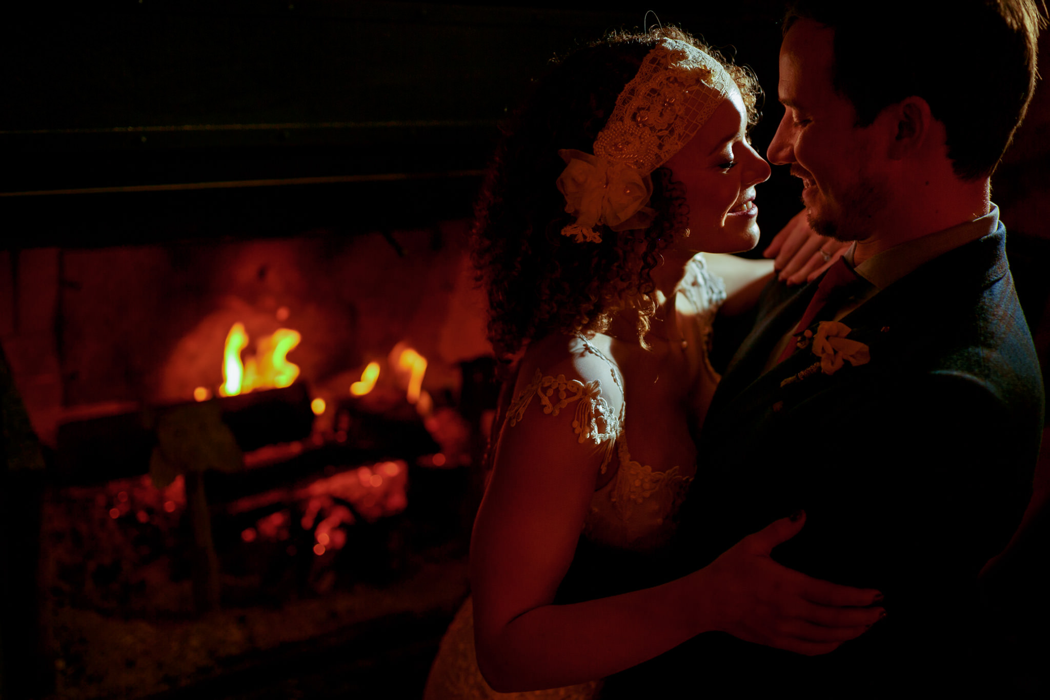 Bride and Groom intimate embrace near fireside at Silcox Hut atop Mt Hood at Timberline LodgeBride and Groom intimate embrace near fireside at Silcox Hut atop Mt Hood at Timberline Lodge