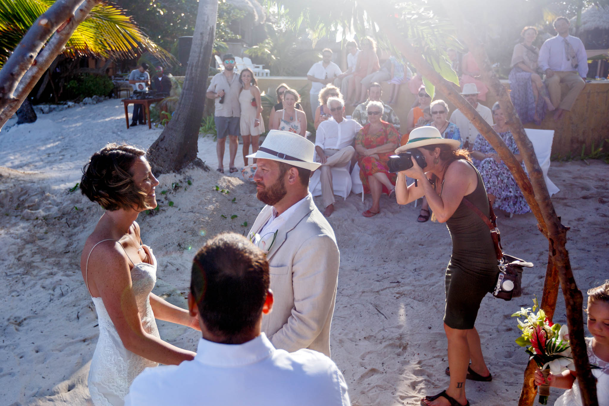 Photographer shooting wedding ceremony in Belize at Portofino Beach Resort