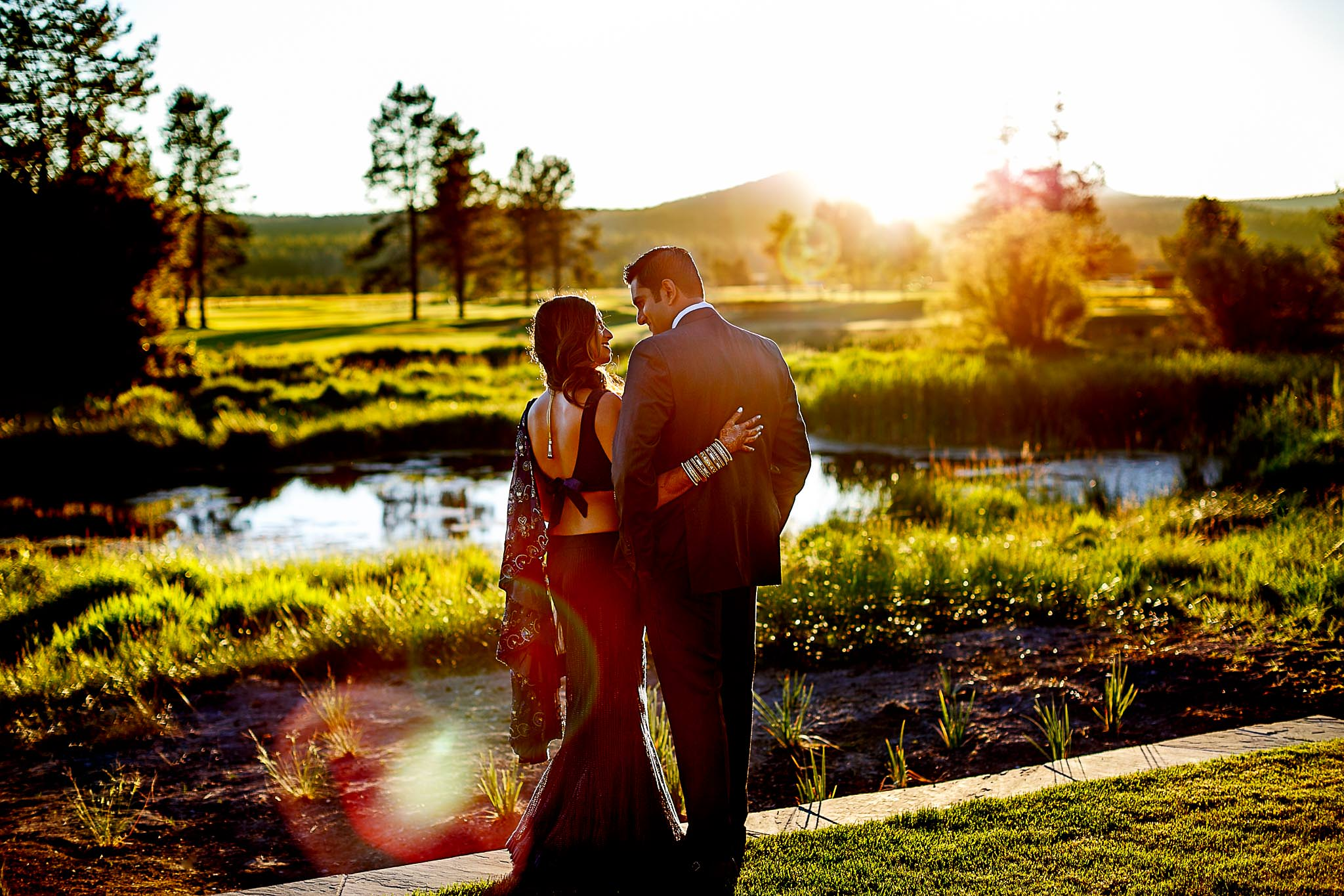 Indian Wedding couple at sunriver resort at sunset