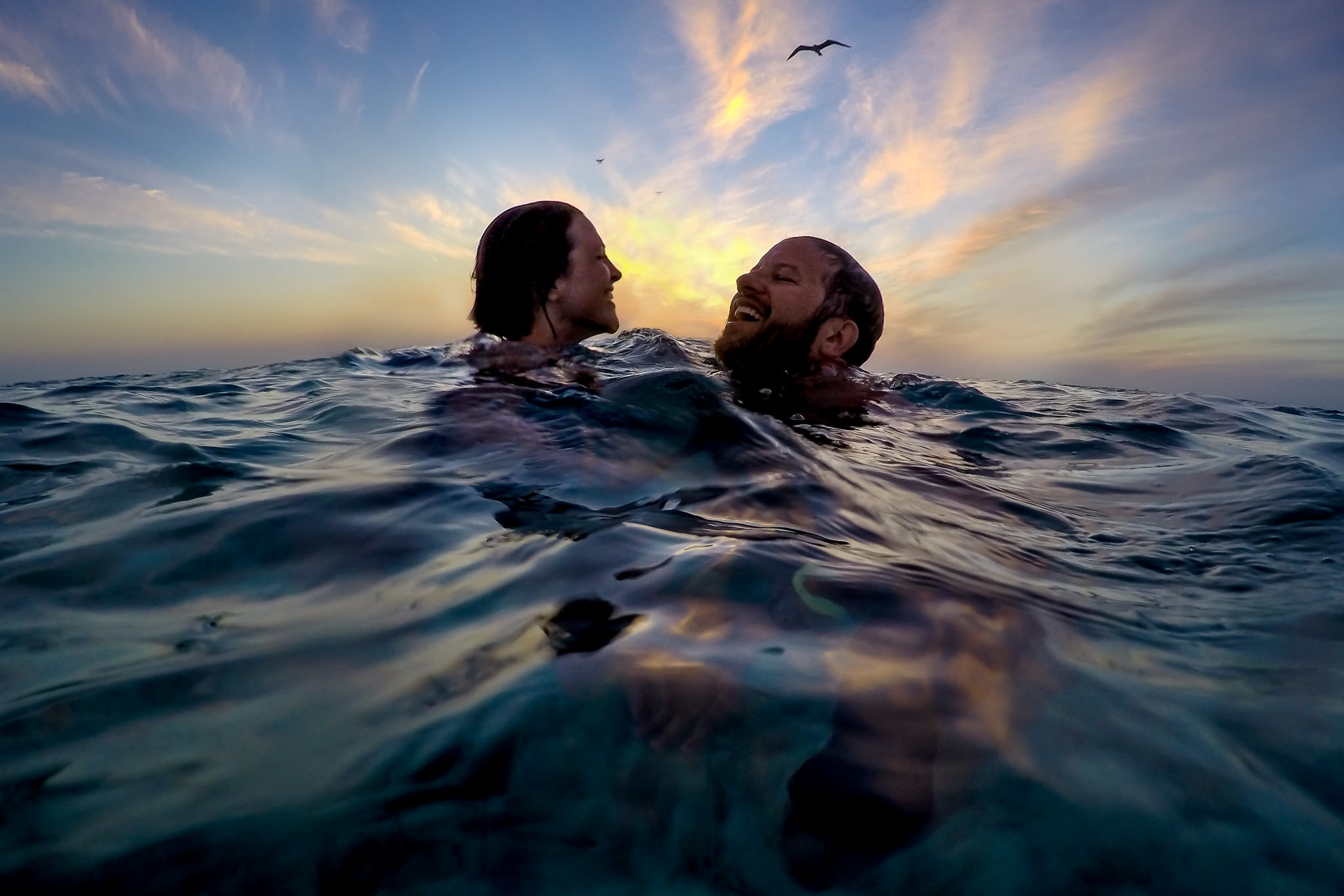 Bride and Groom swimming in Belize ocean day before wedding
