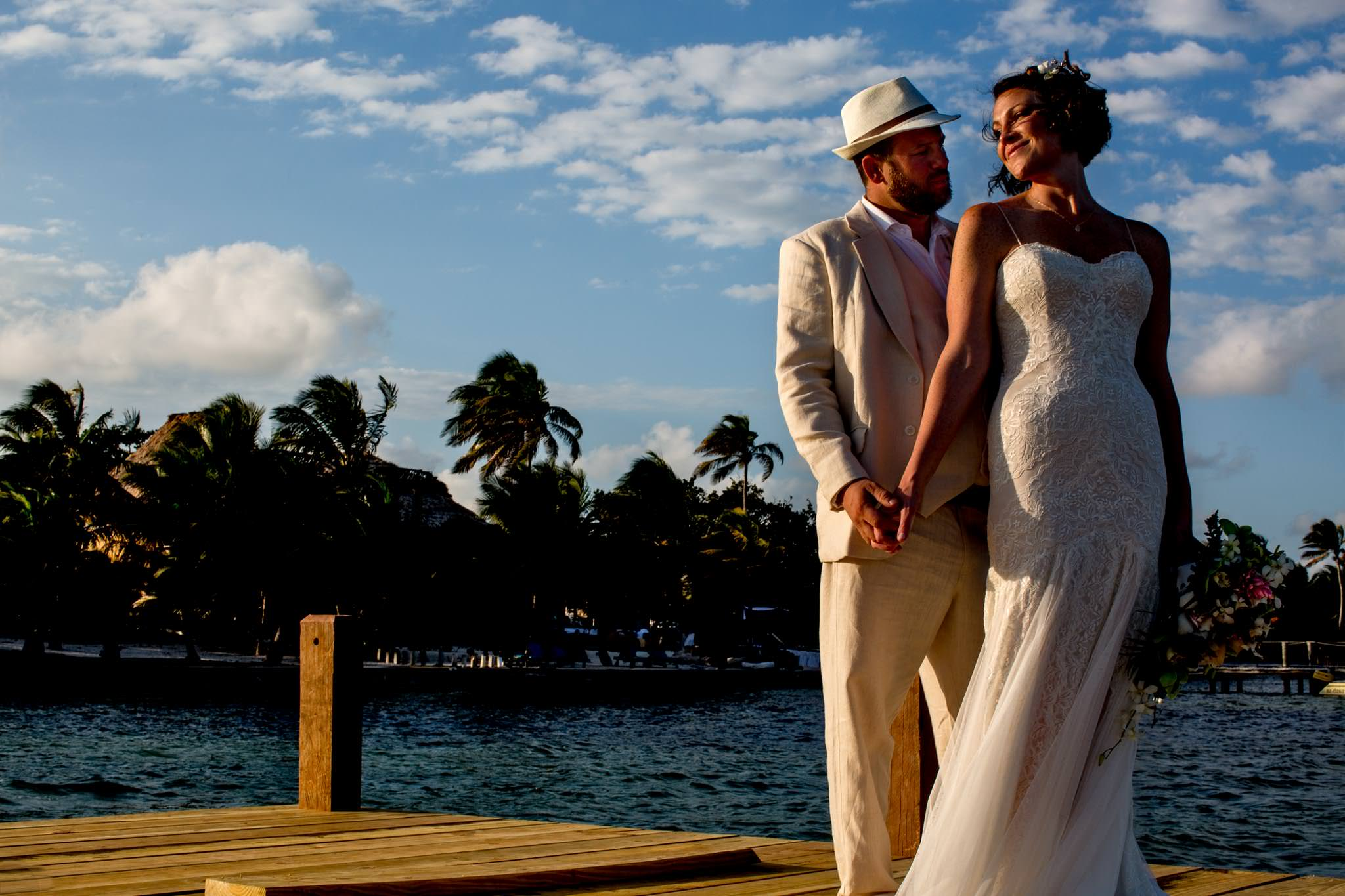 Bride and Groom at sunset in Belize at Portofino Beach Resort