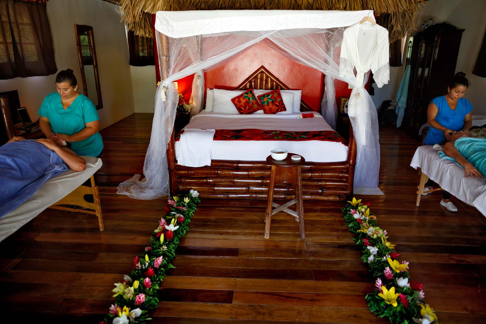 Bride and groom getting massages in Belize at Portofino Beach Resort day after wedding