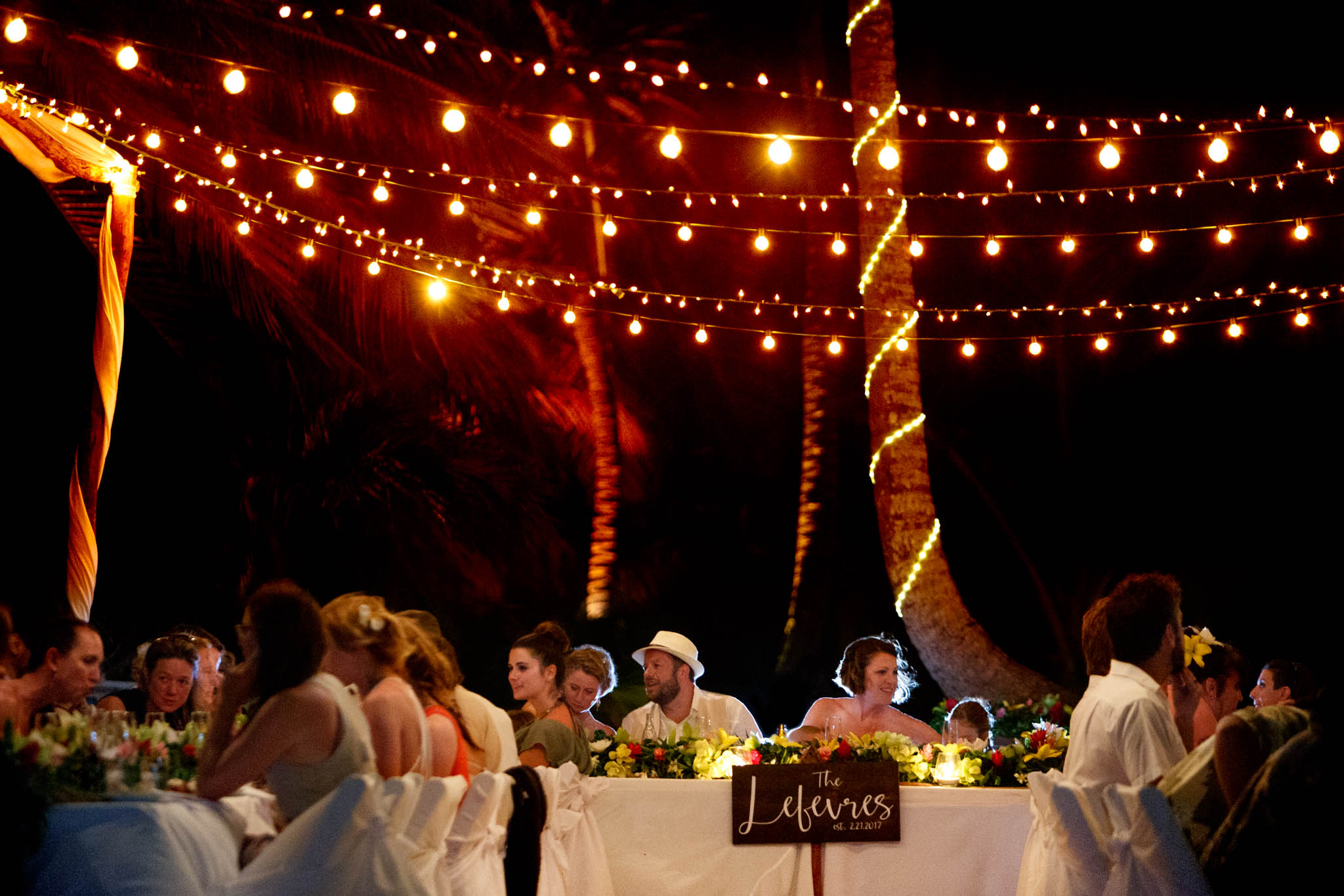 Bride and Groom at reception table in Belize at Portofino Beach Resort
