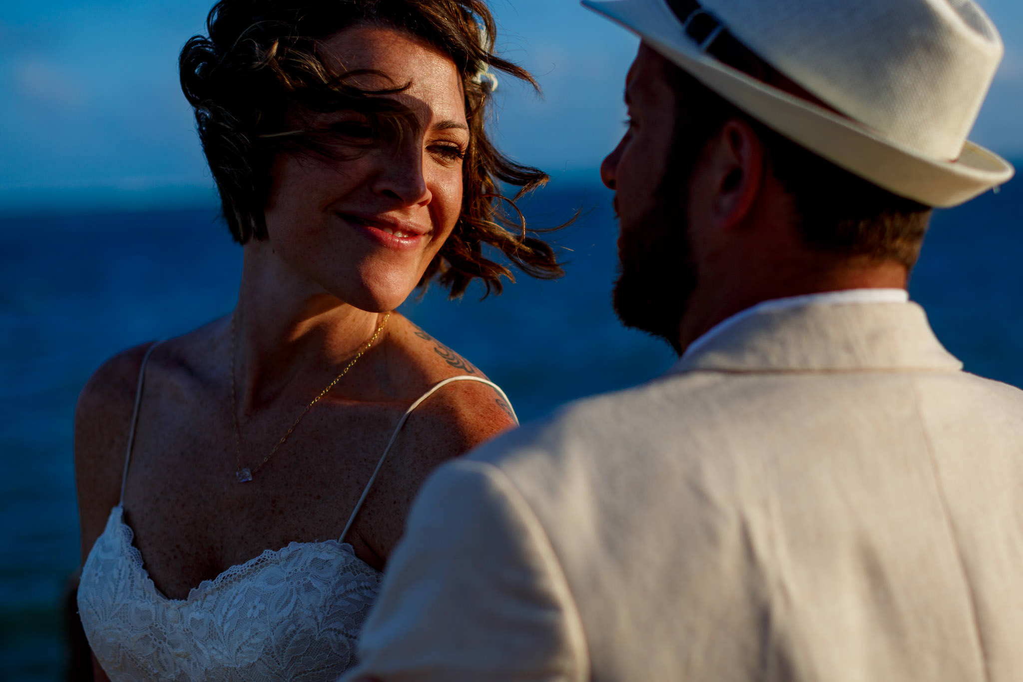 Bride and Groom looking into each other at sunset just after Belize wedding ceremony at Portofino Beach Resort