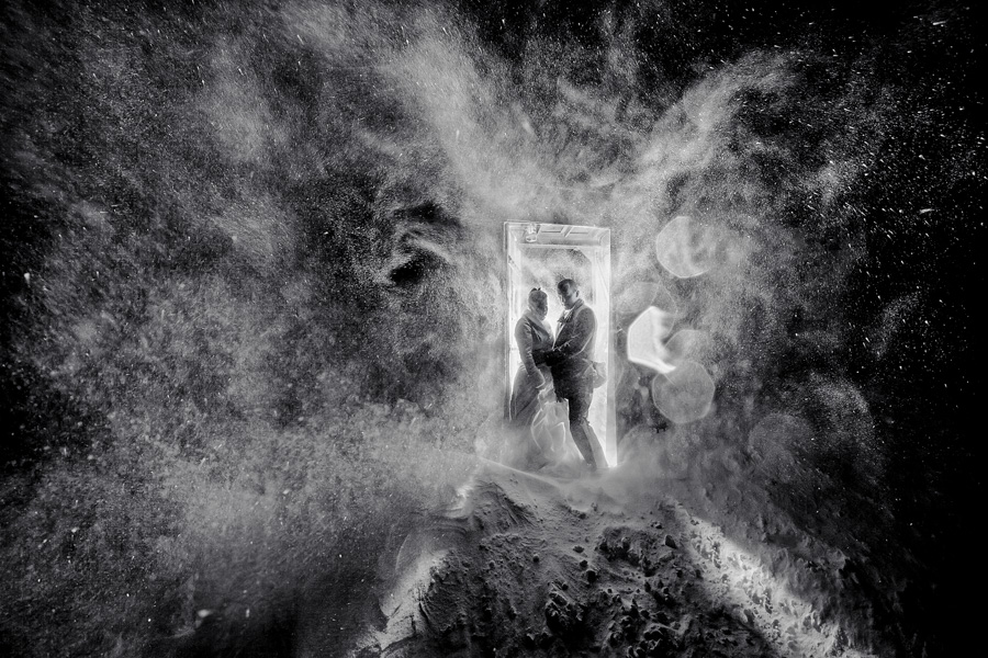 Bride and Groom in wild snow storm at Silcox Hut in doorway
