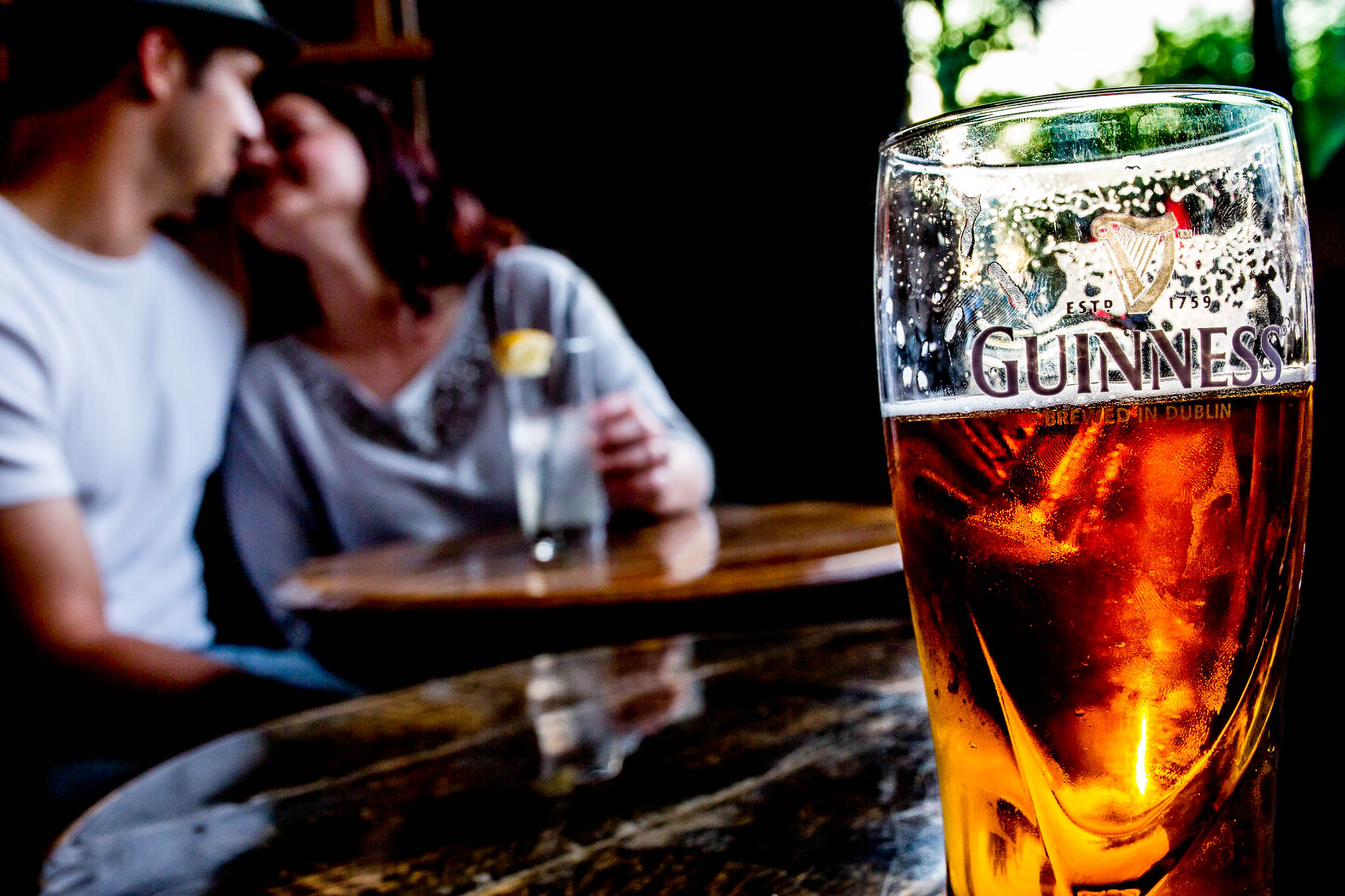 Portland Engagement Photo enjoying a guiness beer