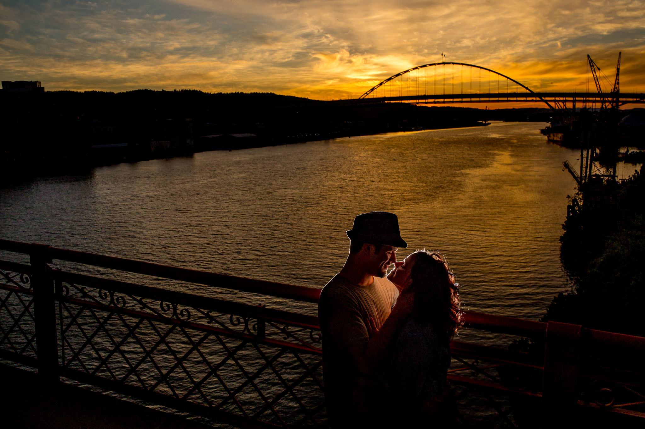 Portland Engagement Photo on Broadway Bridge at Sunset in golden light