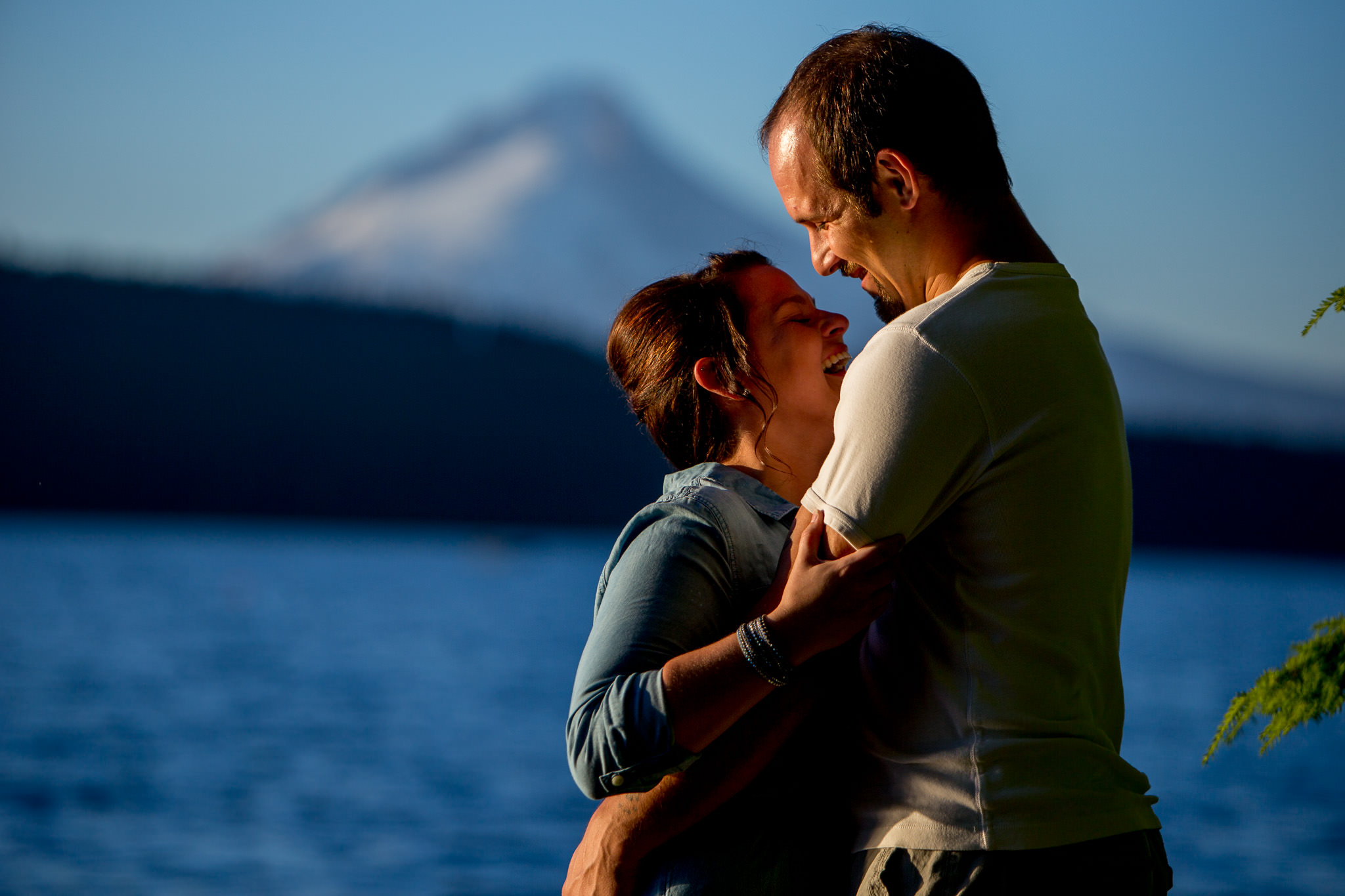 Engagement Photos walking at Timothy Lake at sunset while laughing