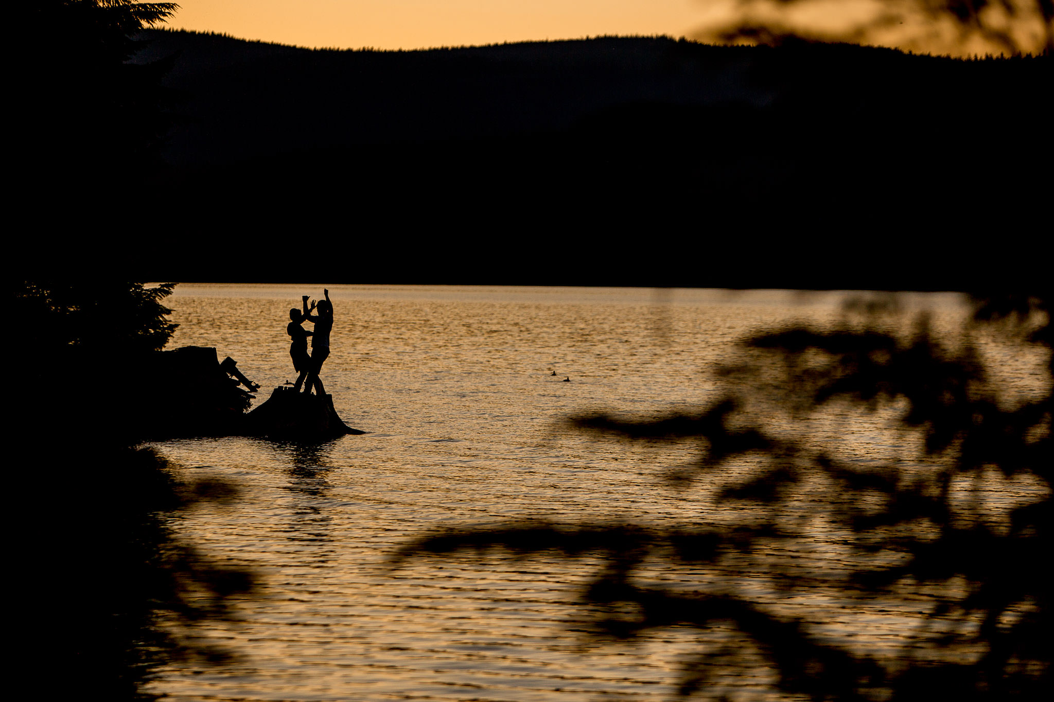 Engagement Photos at Timothy Lake at sunset walking with silhouette dancing
