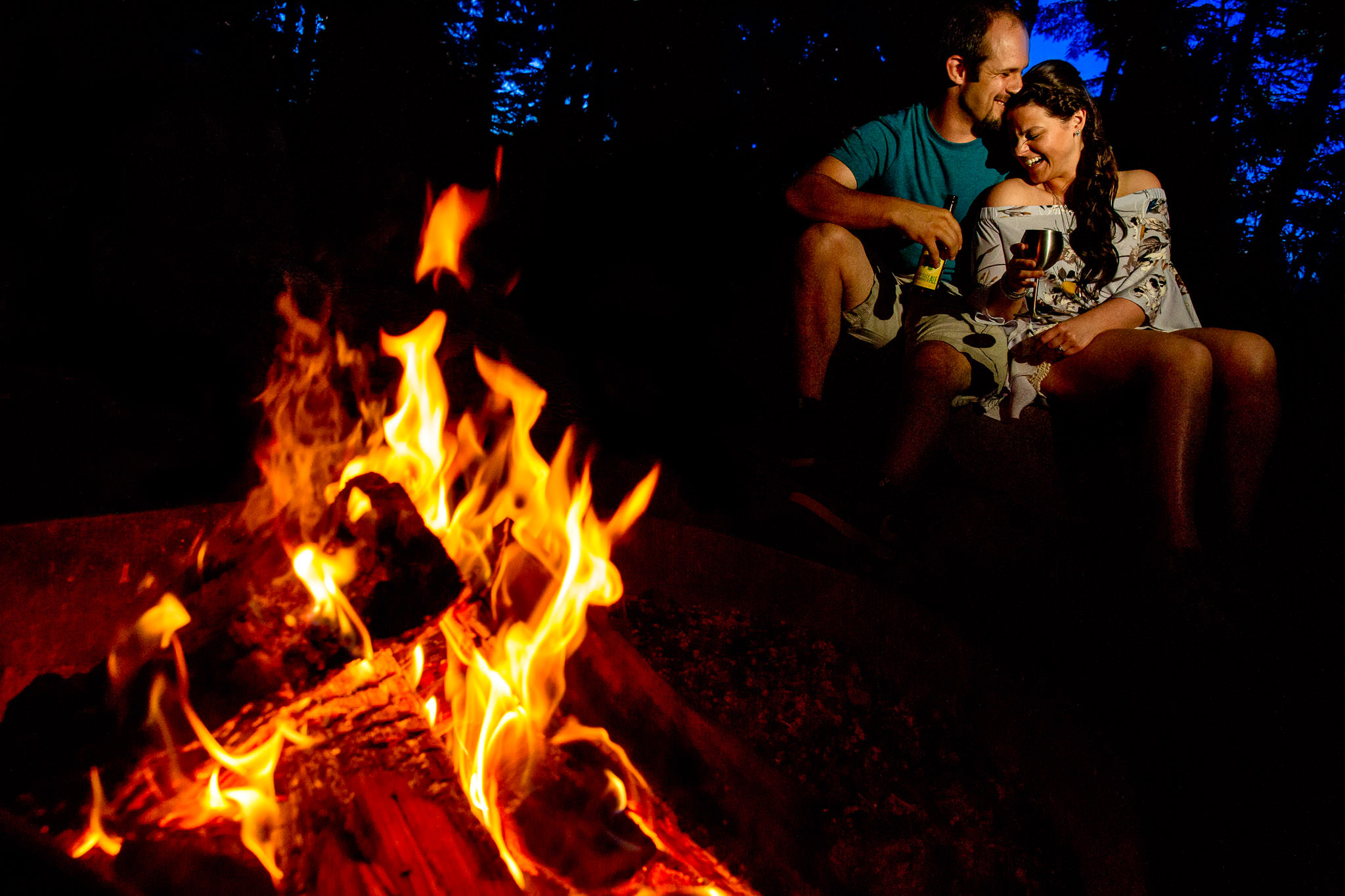 Engagement Photos at Timothy Lake near campfire laughing