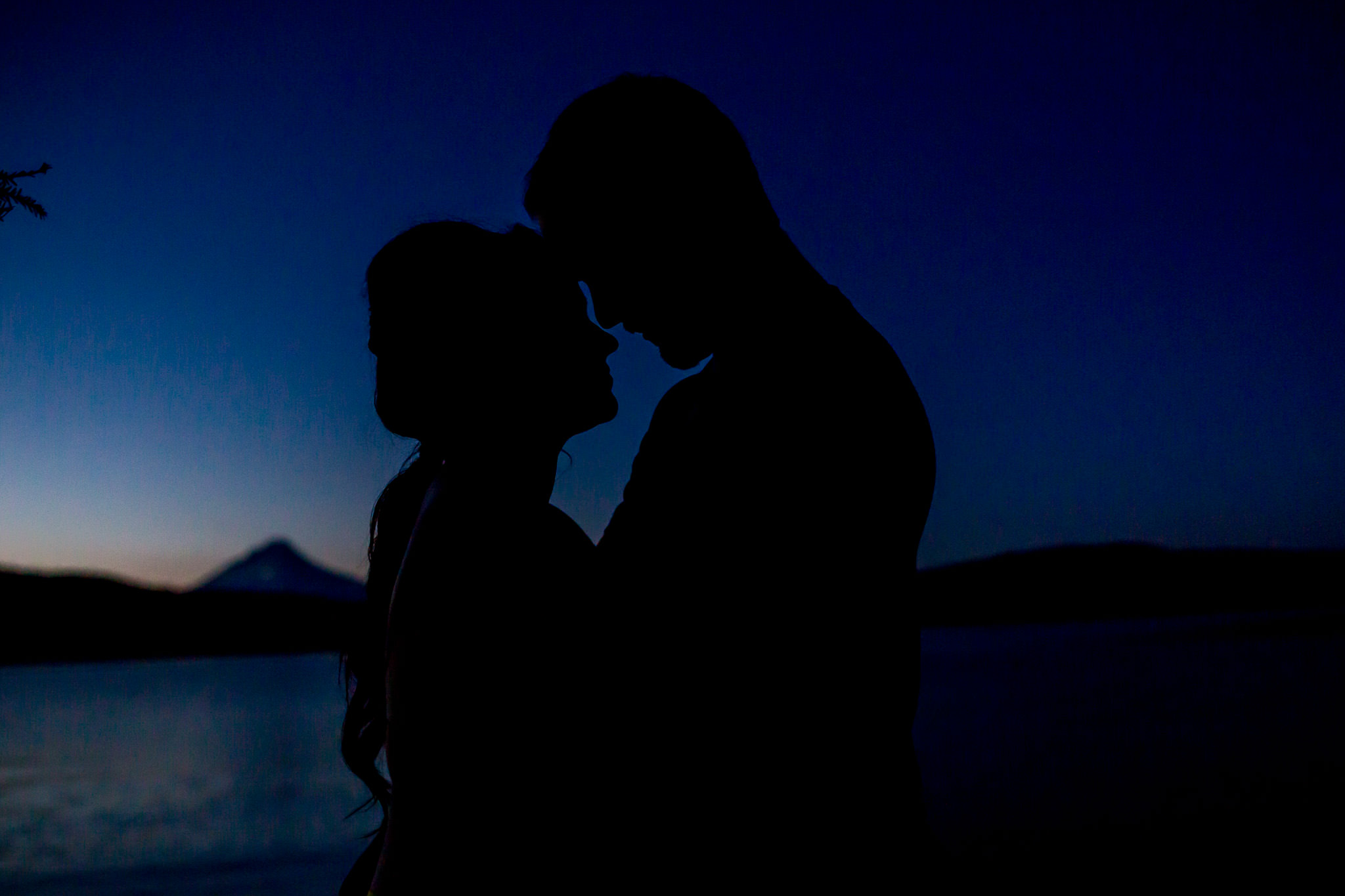 Engagement Photos walking at Timothy Lake with intimate silhouette