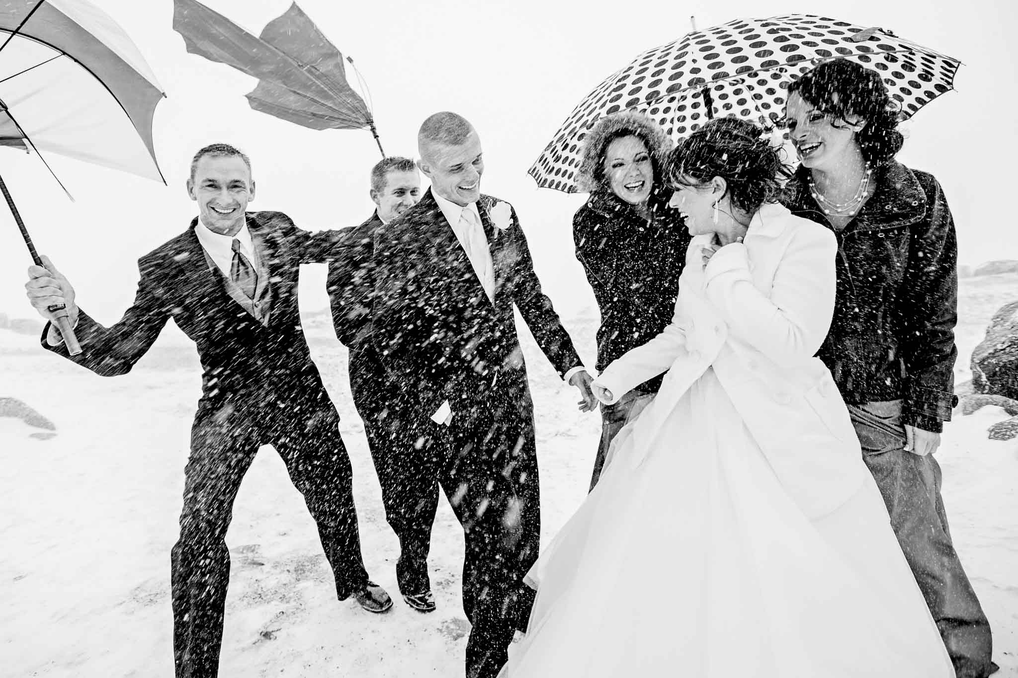 Bridal party laughing in snow blizzard just outside Silcox Hut
