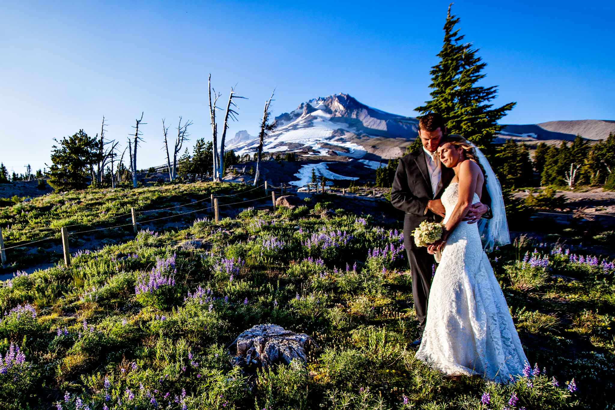 Summertime wedding atop Timberline Lodge with bride and groom in beautiful sunset light