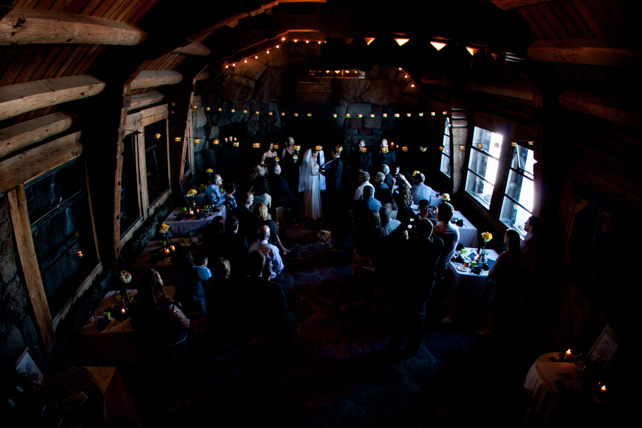 Bride and Groom in intimate wedding ceremony inside Silcox Hut atop Mt Hood at Timberline Lodge