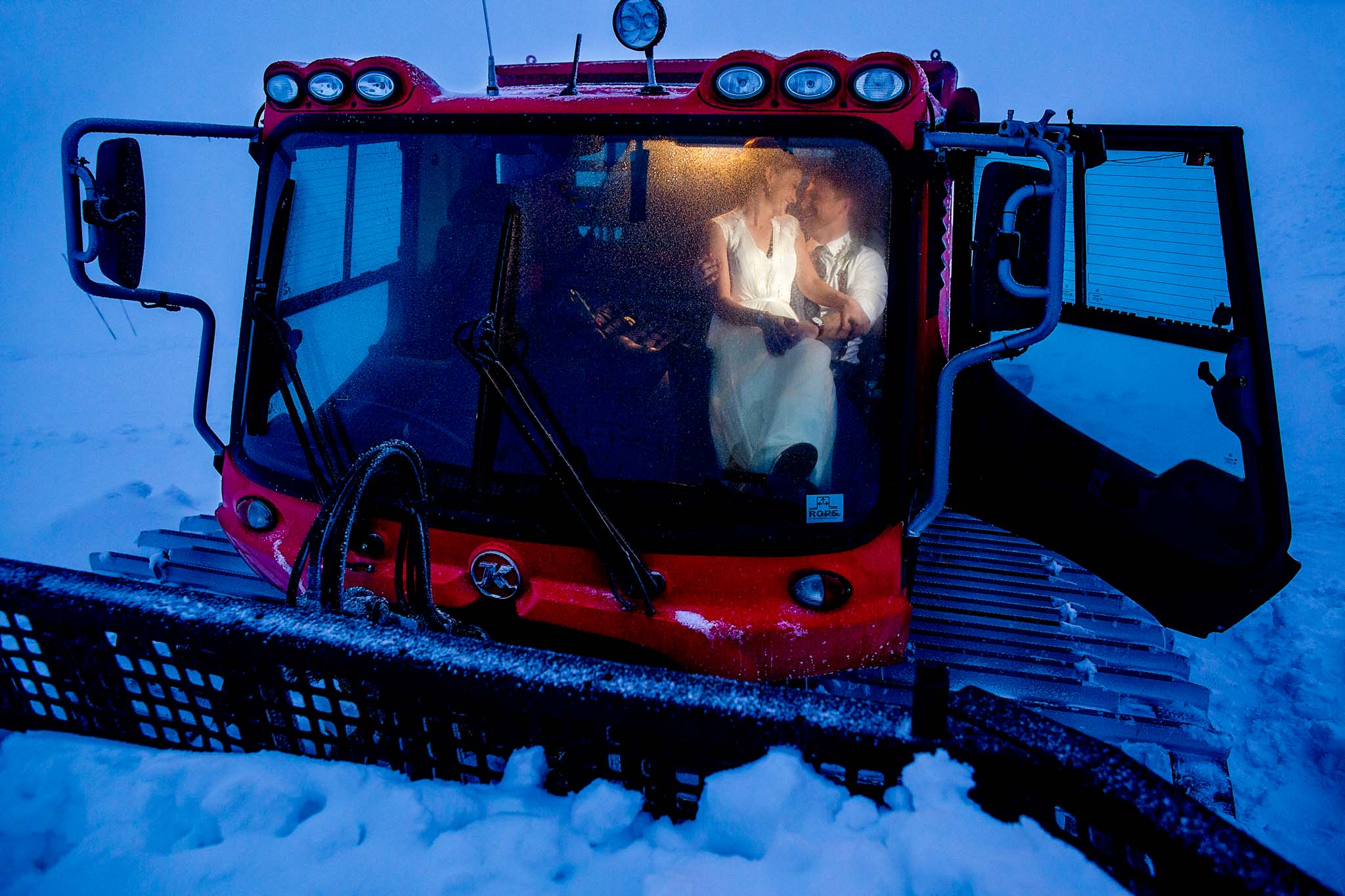Bride and Groom sitting in snow cat drivers seat atop Mt Hood above Timberline Lodge near Silcox Hut