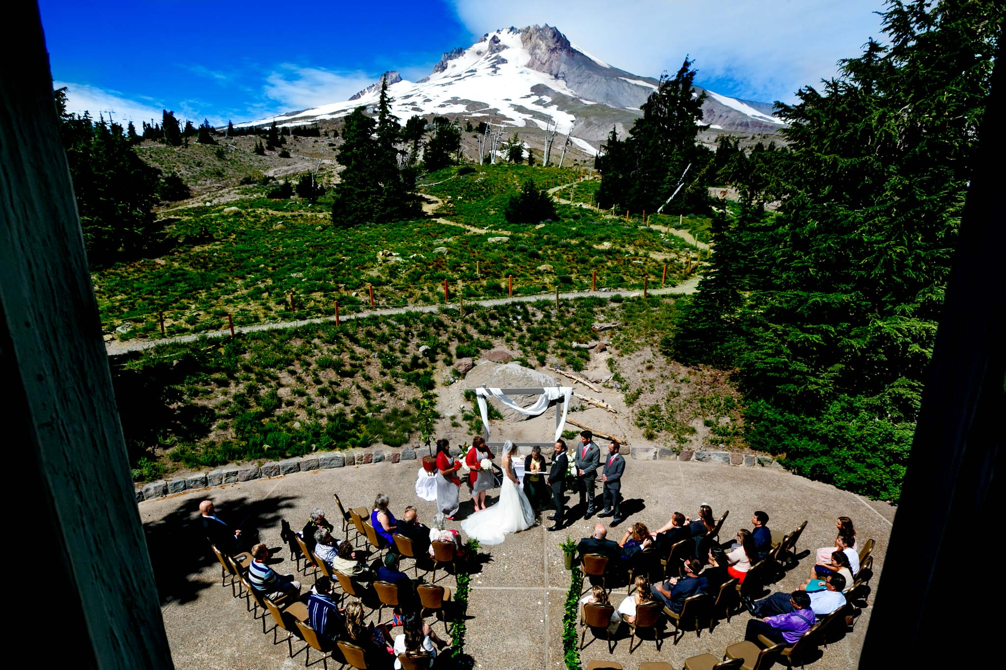 Bride and Groom in Summer summer wedding ceremony at Timberline Lodge with Mt Hood in backdrop