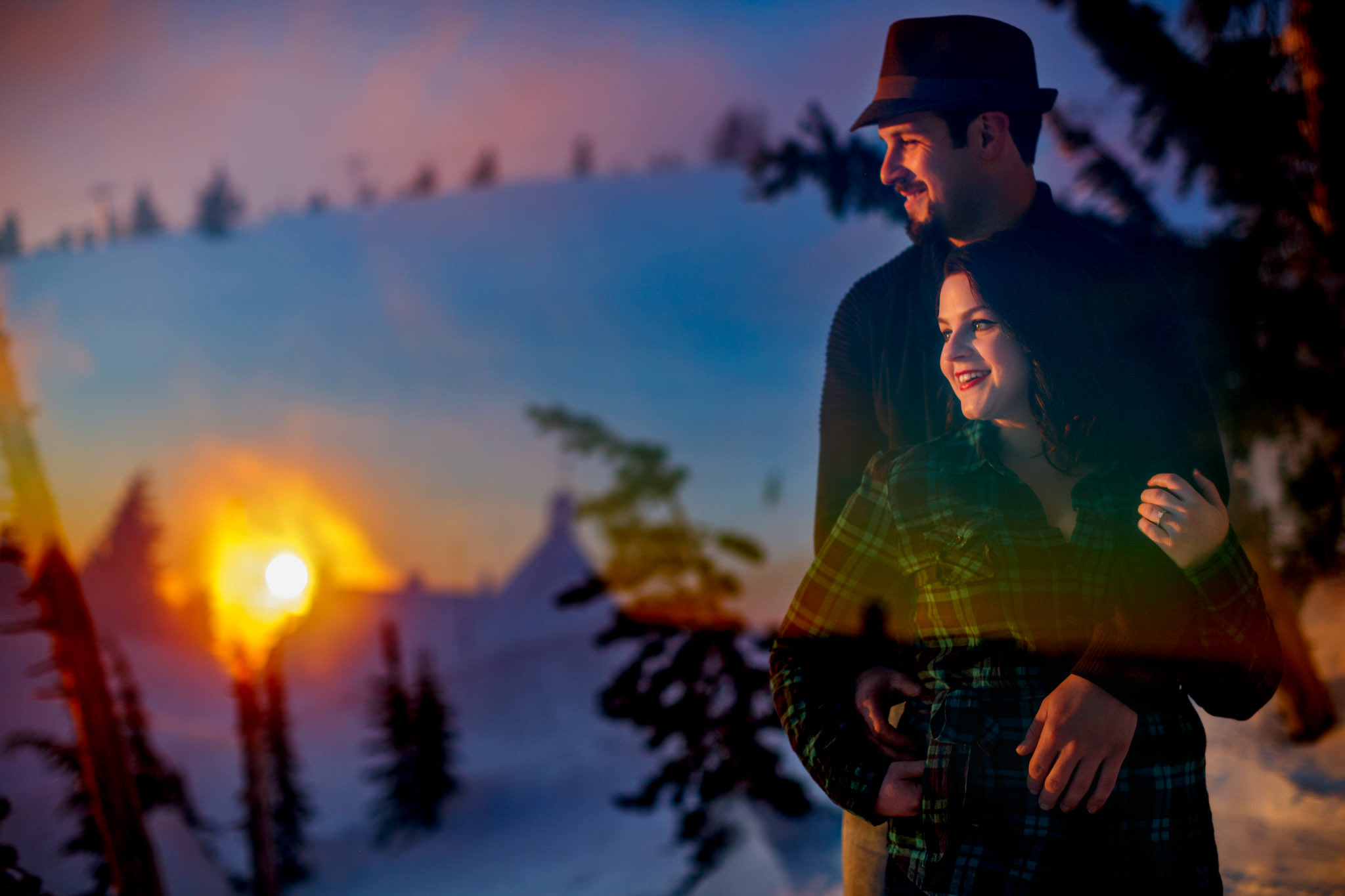 Engagement portrait of couple at sunset atop Mt Hood at Timberline Lodge